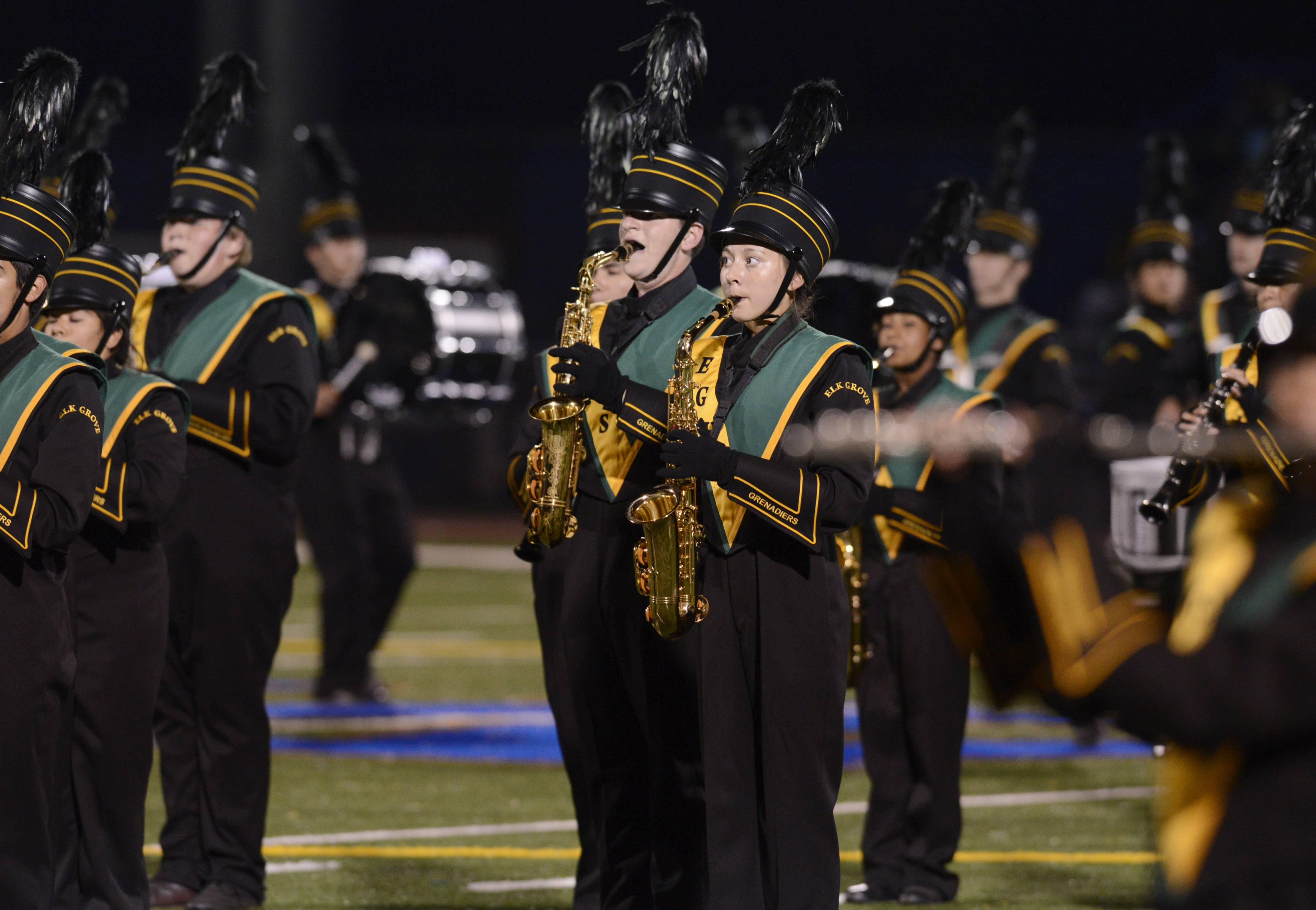 The Elk Grove High School Marching Band performs Saturday during the annual Chicagoland Marching Band Festival at Wheeling High School.
