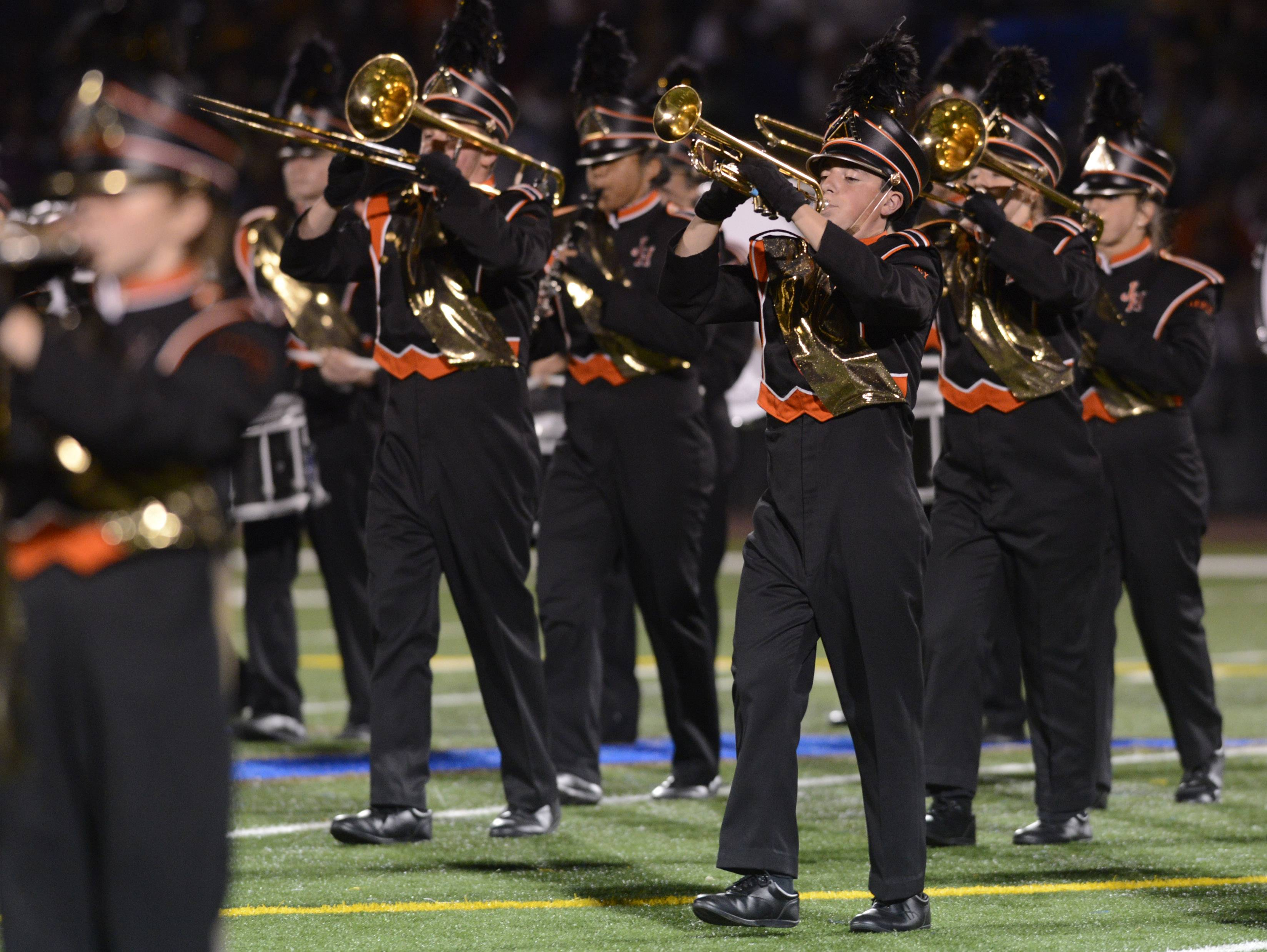The Hersey High School Marching Band performs Saturday during the annual Chicagoland Marching Band Festival at Wheeling High School.