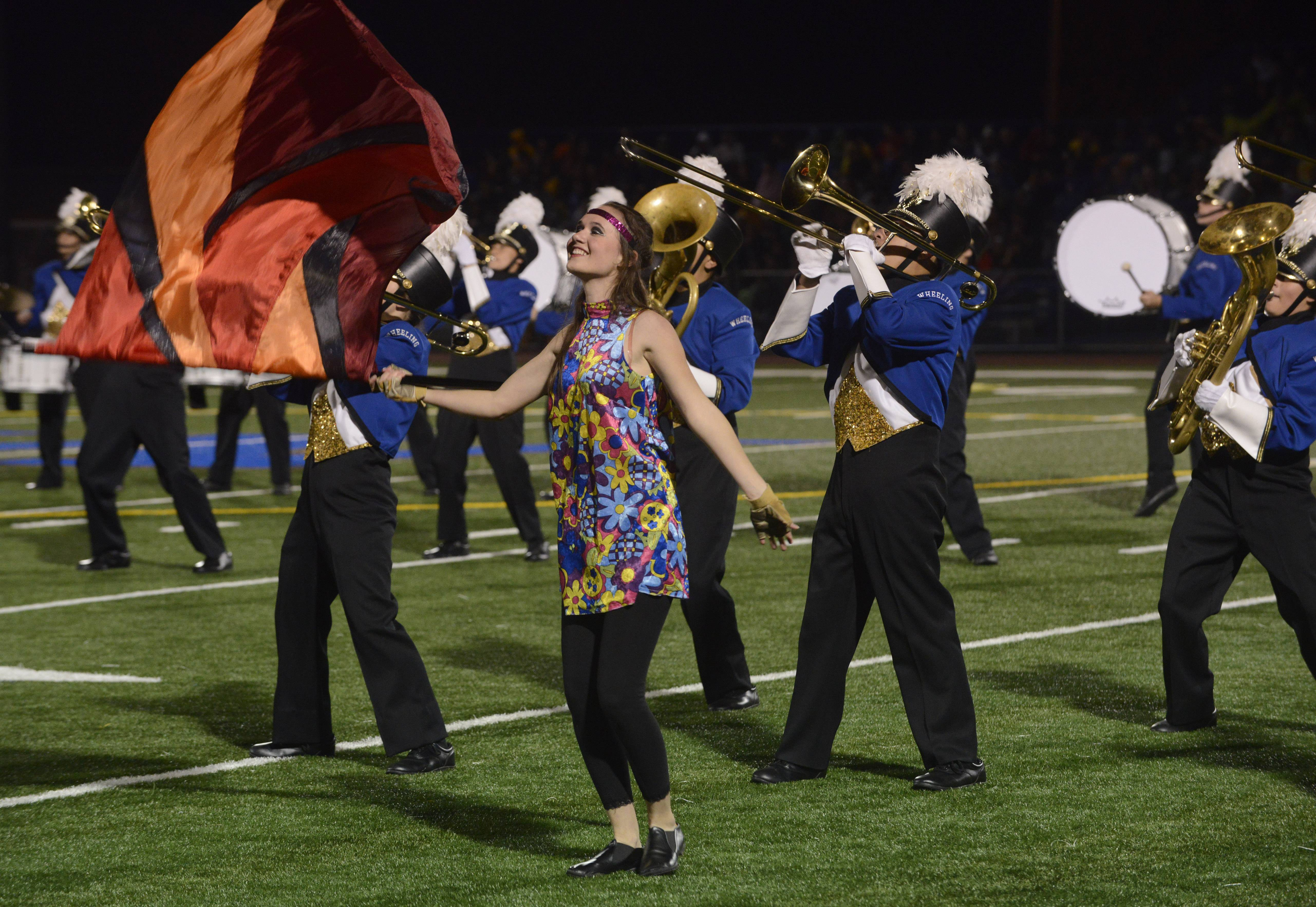 The Wheeling High School Marching Band gives an exhibition performance Saturday during the annual Chicagoland Marching Band Festival at Wheeling High School.