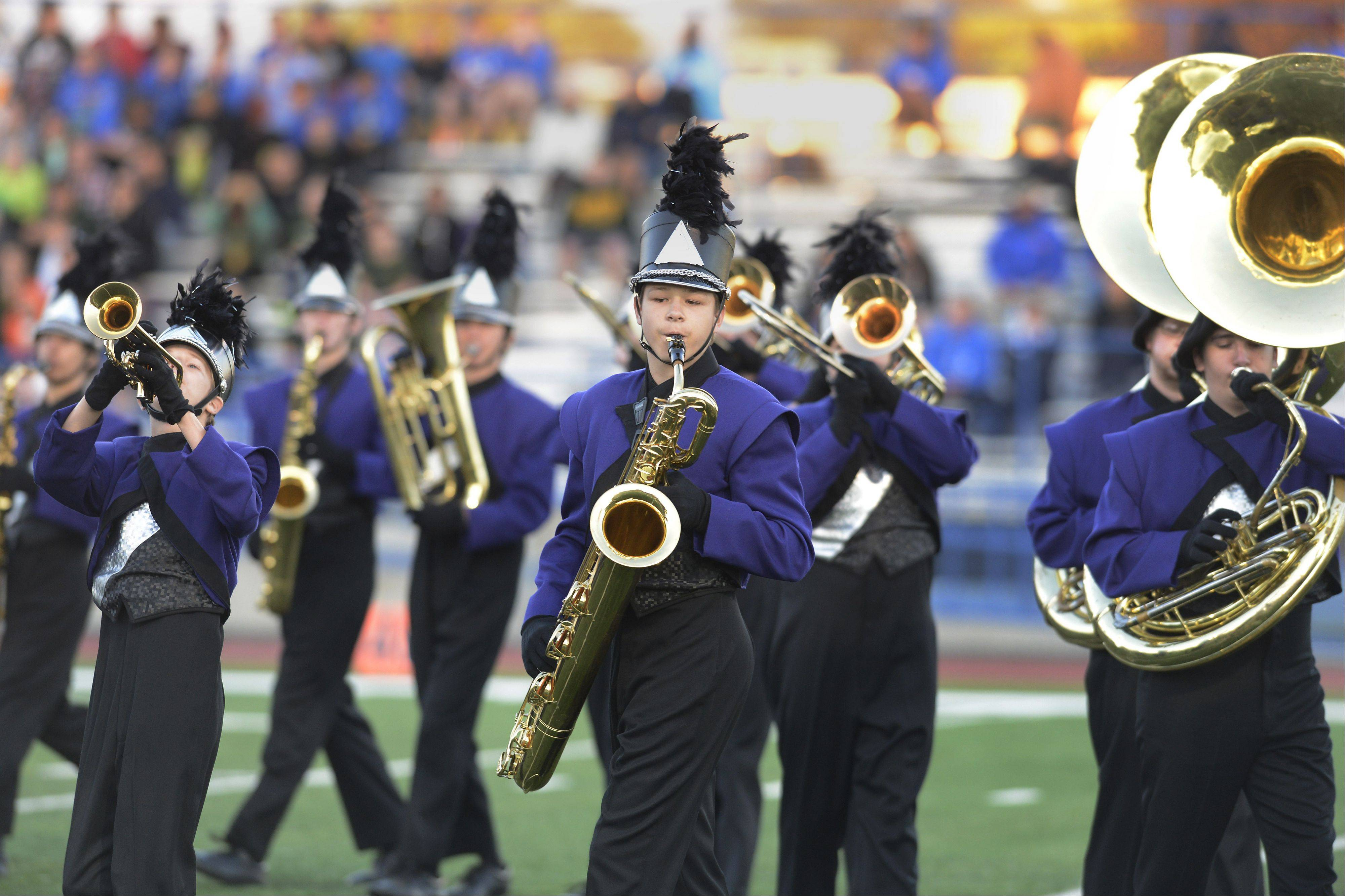 The Rolling Meadows Marching Mustangs perform during the annual Chicagoland Marching Band Festival at Wheeling High School Saturday.