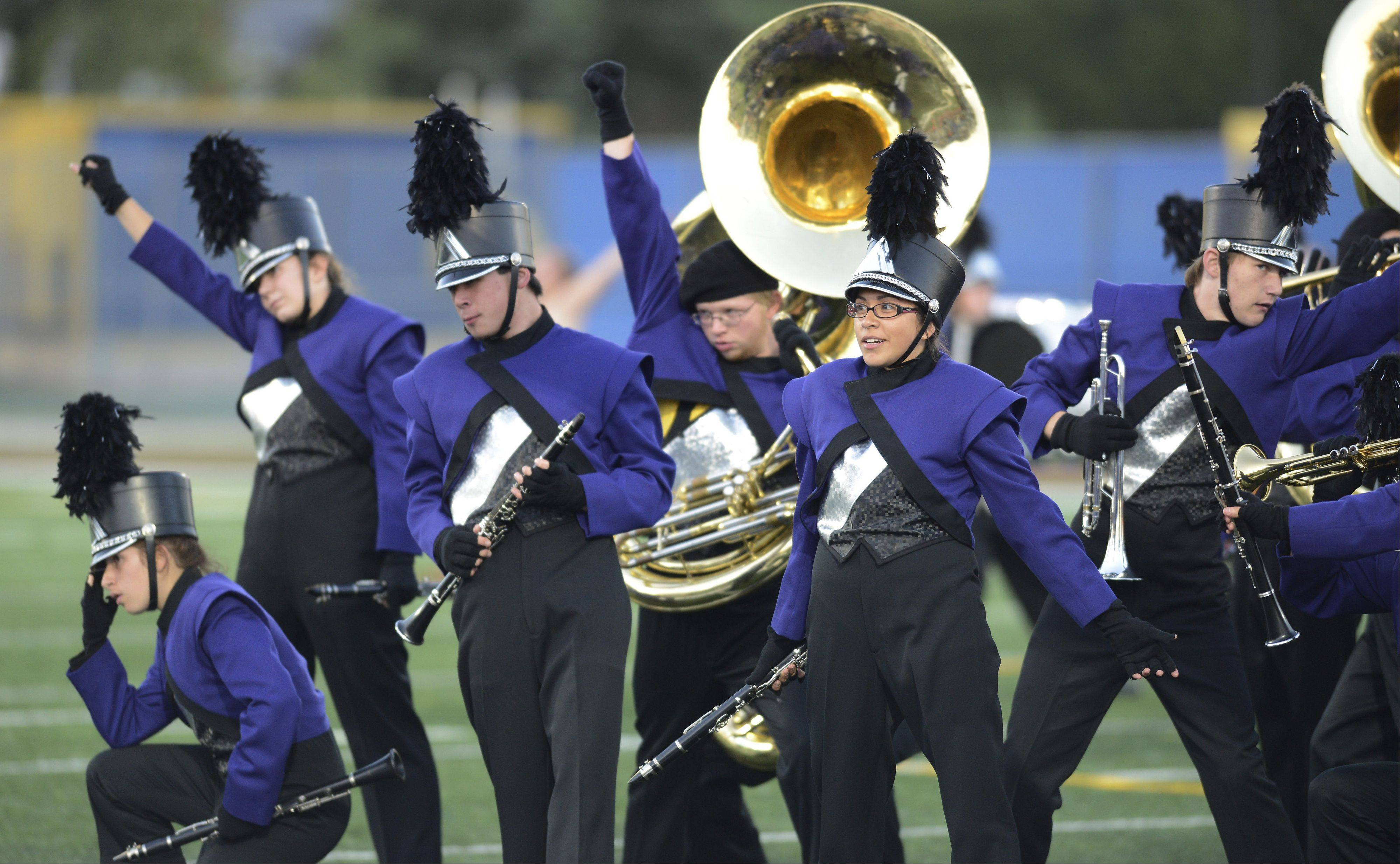 The Rolling Meadows Marching Mustangs complete their performance during the annual Chicagoland Marching Band Festival at Wheeling High School Saturday.