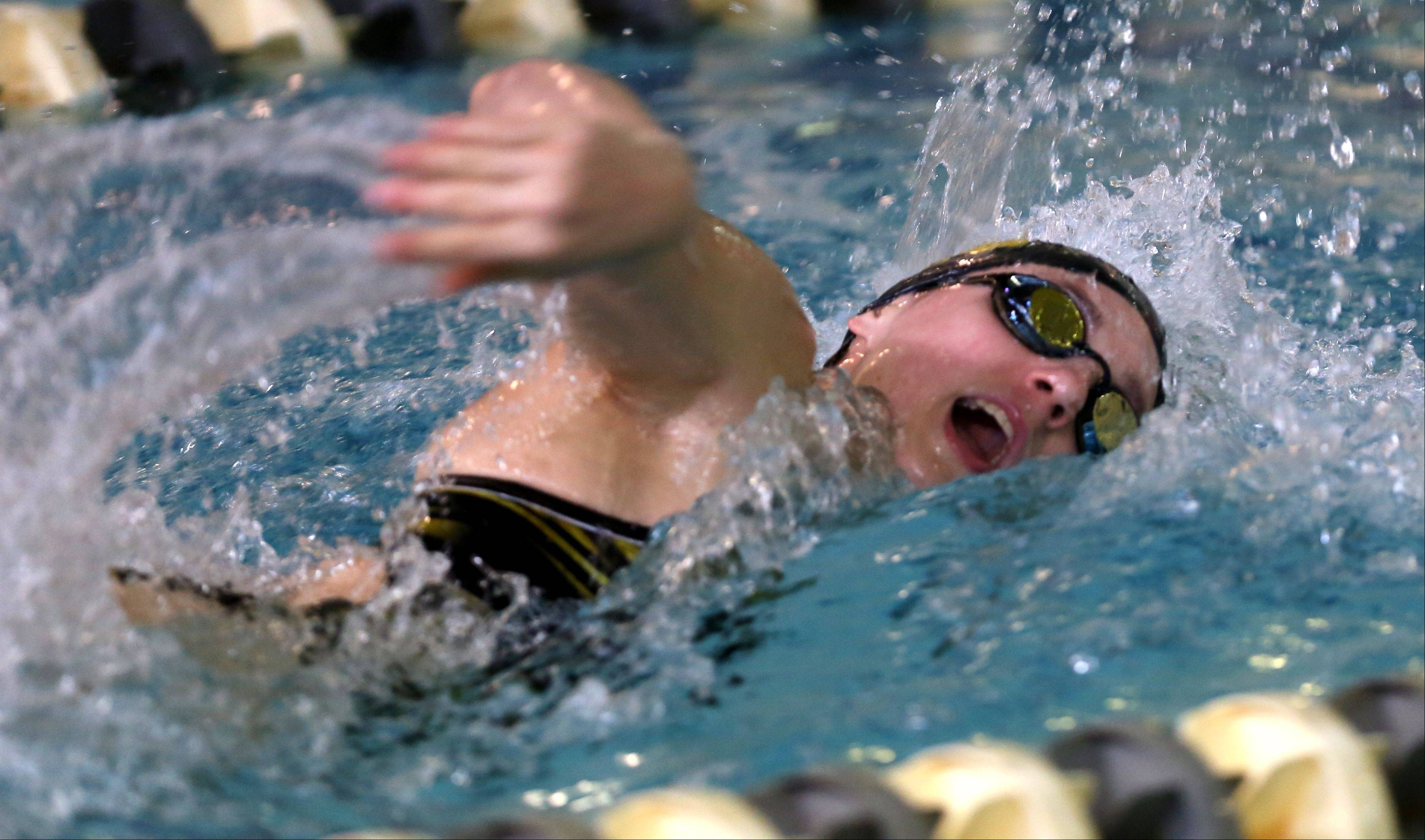 Metea Valley's Amanda Burson wins the 100-yard freestyle, during the girls swimming's Wildcat Invite at West Chicago High School.