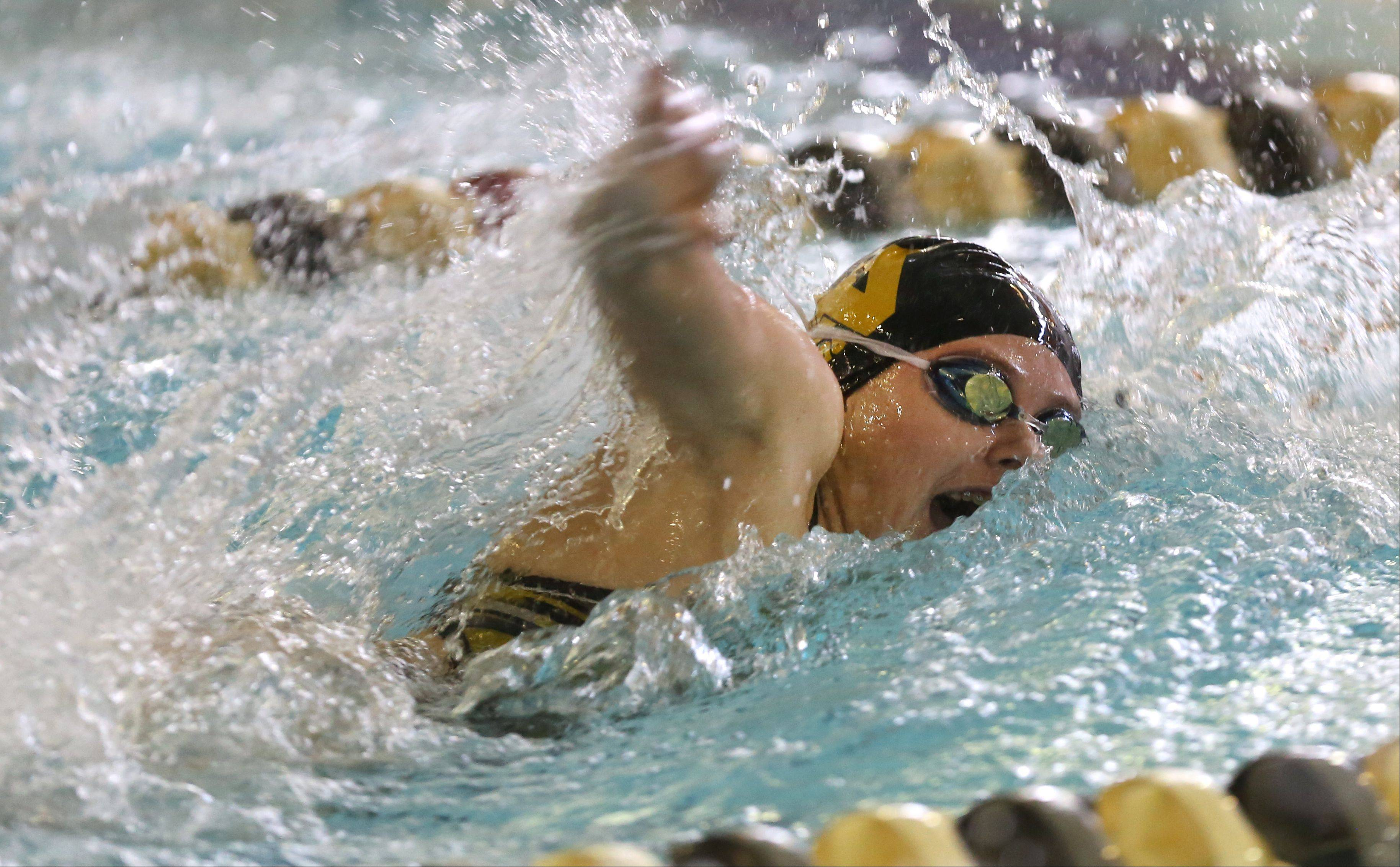Metea Valley's Amanda Burson wins the 50-yard freestyle, during the girls swimming's Wildcat Invite at West Chicago High School.