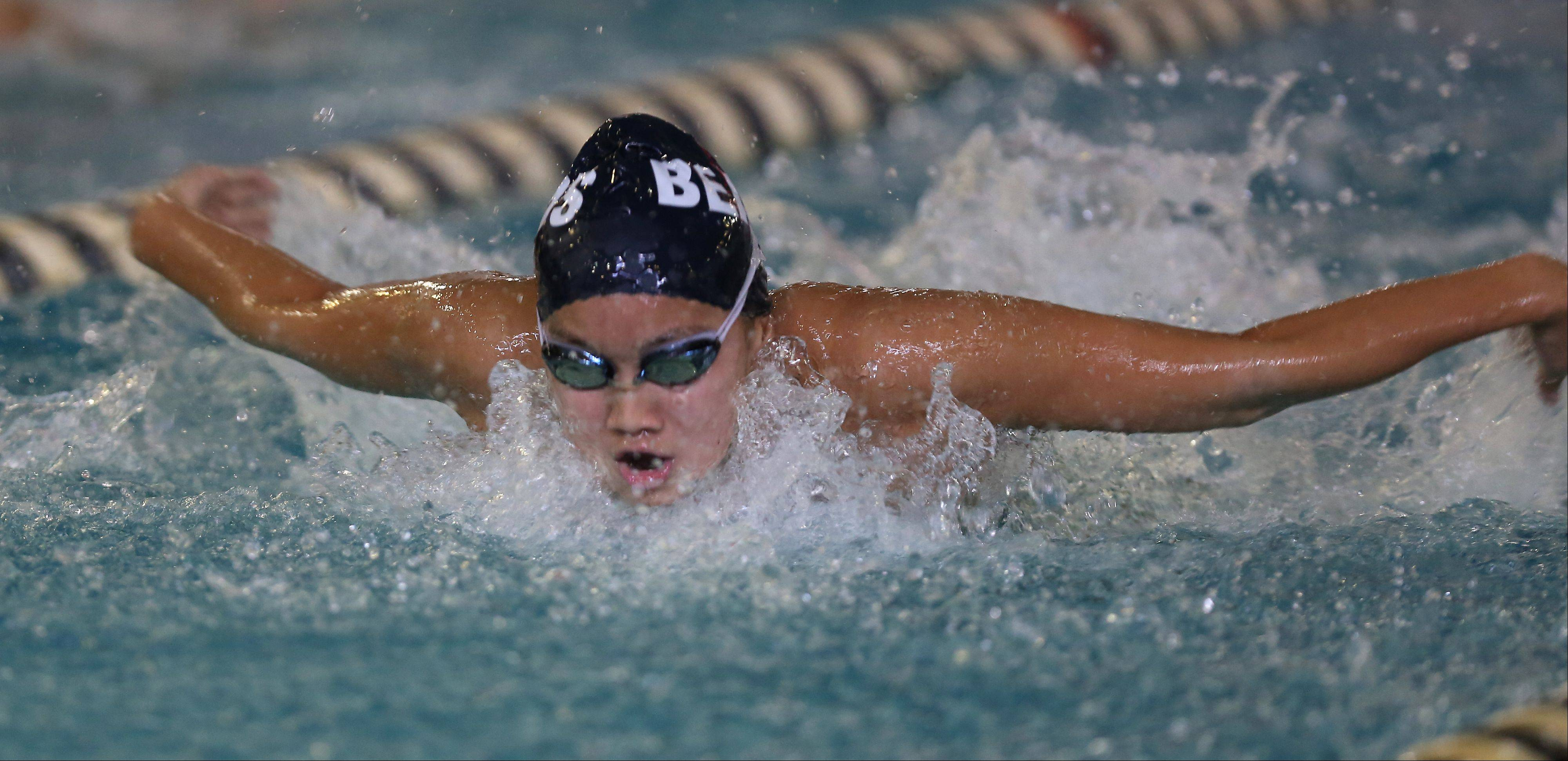Annie Gosselin of Rosary wins the 100 yard butterfly, during girls swimming's Wildcat Invite at West Chicago High School.