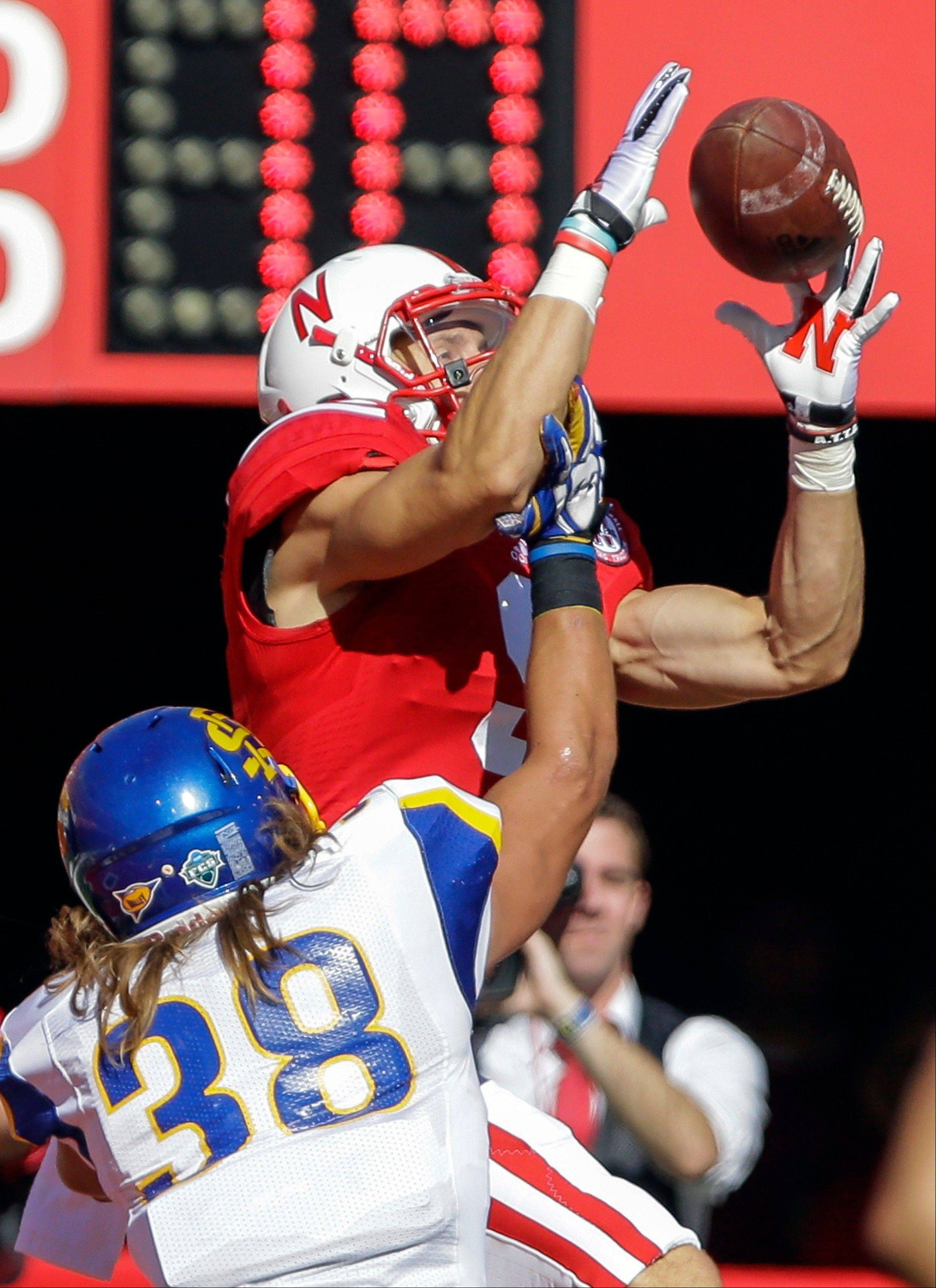 Nebraska wide receiver Sam Burtch, top, catches a touchdown pass over South Dakota State defensive back Jake Gentile in the first half of Saturday's game in Lincoln, Neb.