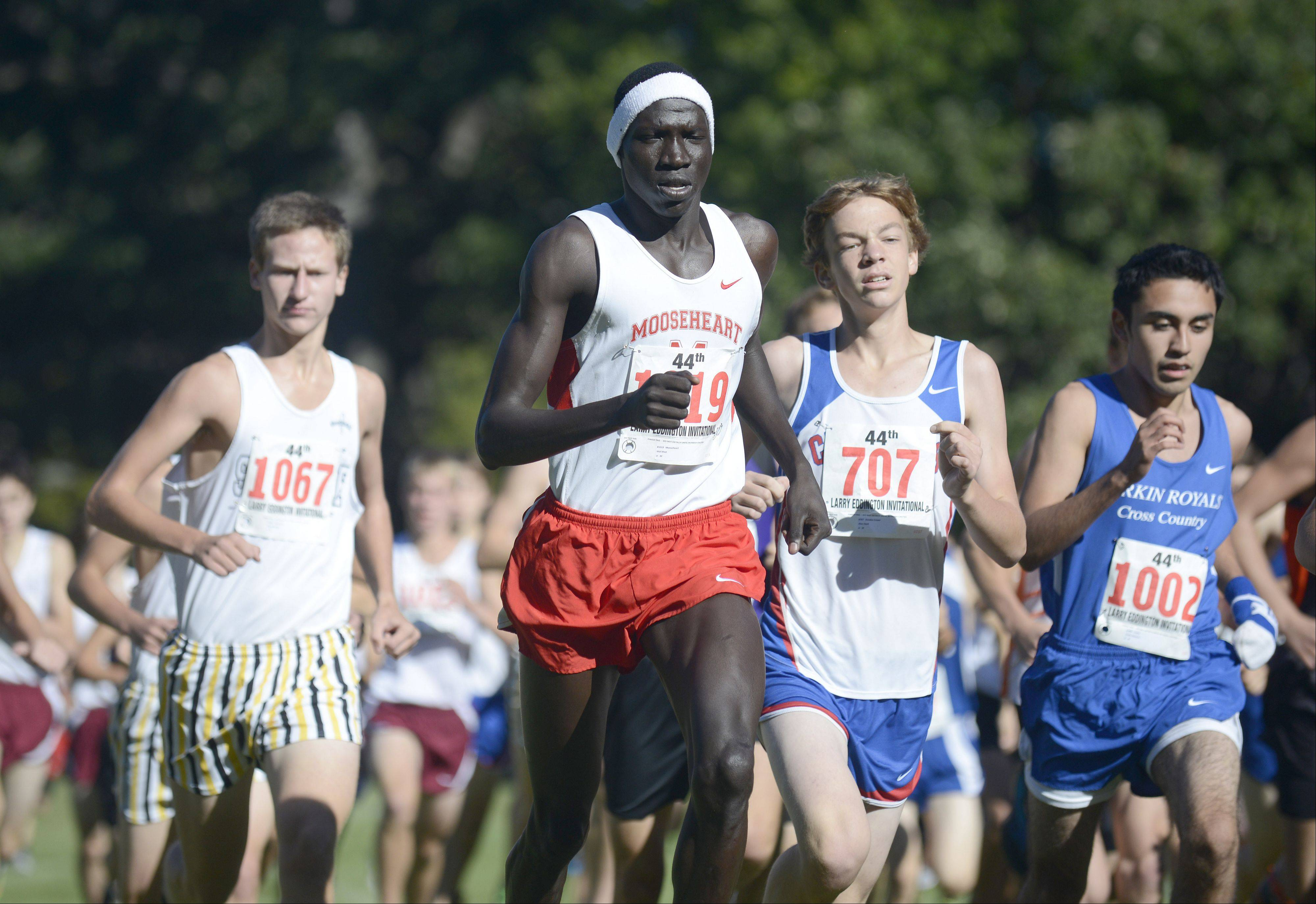 Mooseheart's Wal Khat takes off with the pack at the start of the boys varsity race at the Kaneland Invitational cross country meet in Elburn on Saturday, September 21.