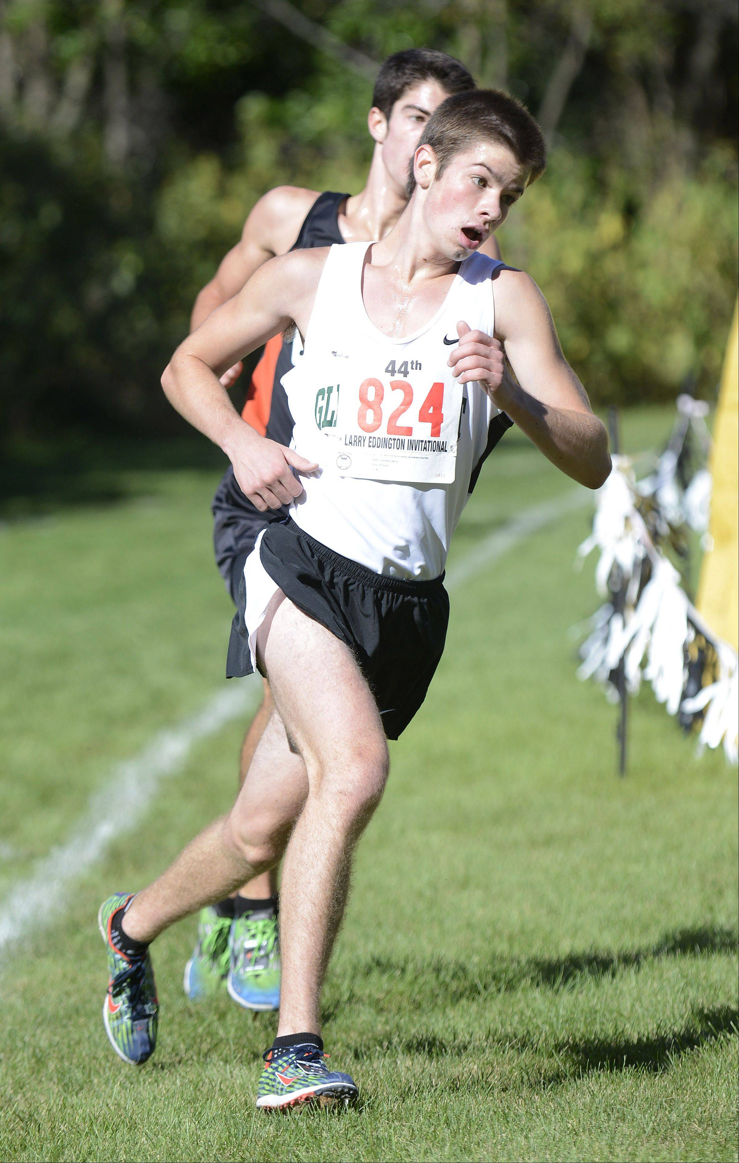Glenbard West's Paul Christian makes the final turn towards the finish line to take third place at the Kaneland Invitational cross country meet in Elburn on Saturday, September 21.