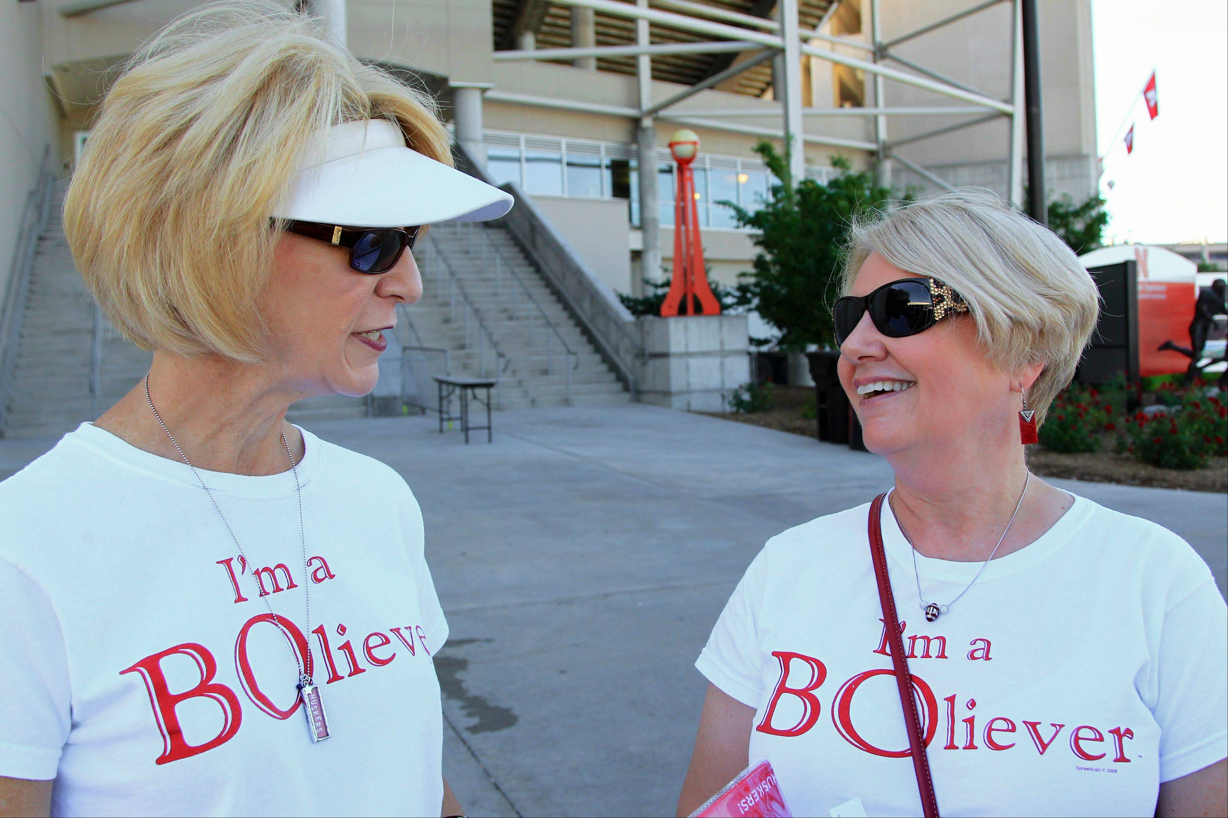 Karen Shelton, left, and her sister Sue Schrader, both of Lincoln, Neb., wear shirts in support of Nebraska head coach Bo Pelini on Saturday outside of Memorial Stadium before game between South Dakota State and Nebraska.
