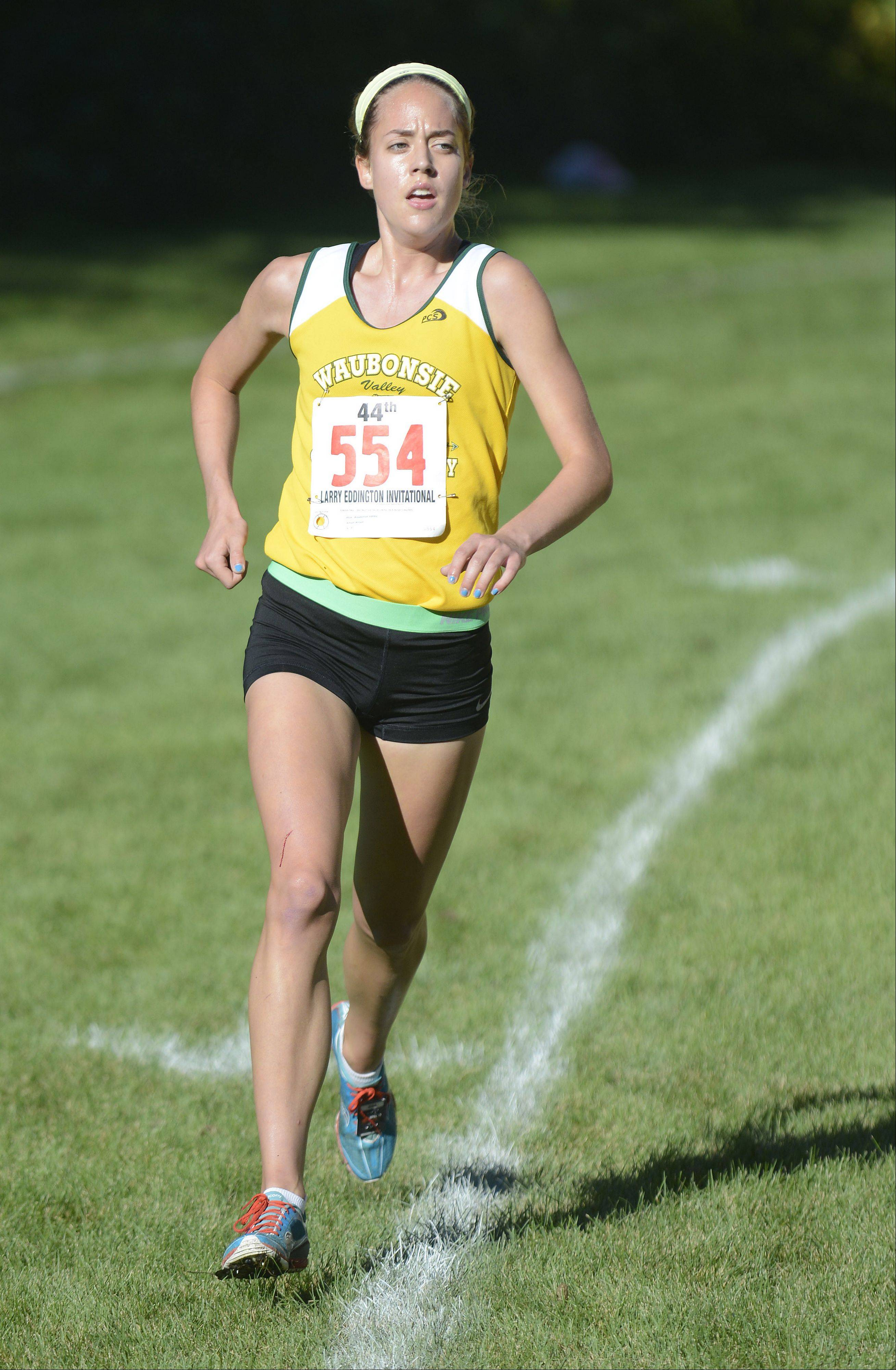 Waubonsie Valley's Allison Wilson nears the finish line and takes eleventh place, first for her team, at the Kaneland Invitational cross country meet in Elburn on Saturday, September 21.