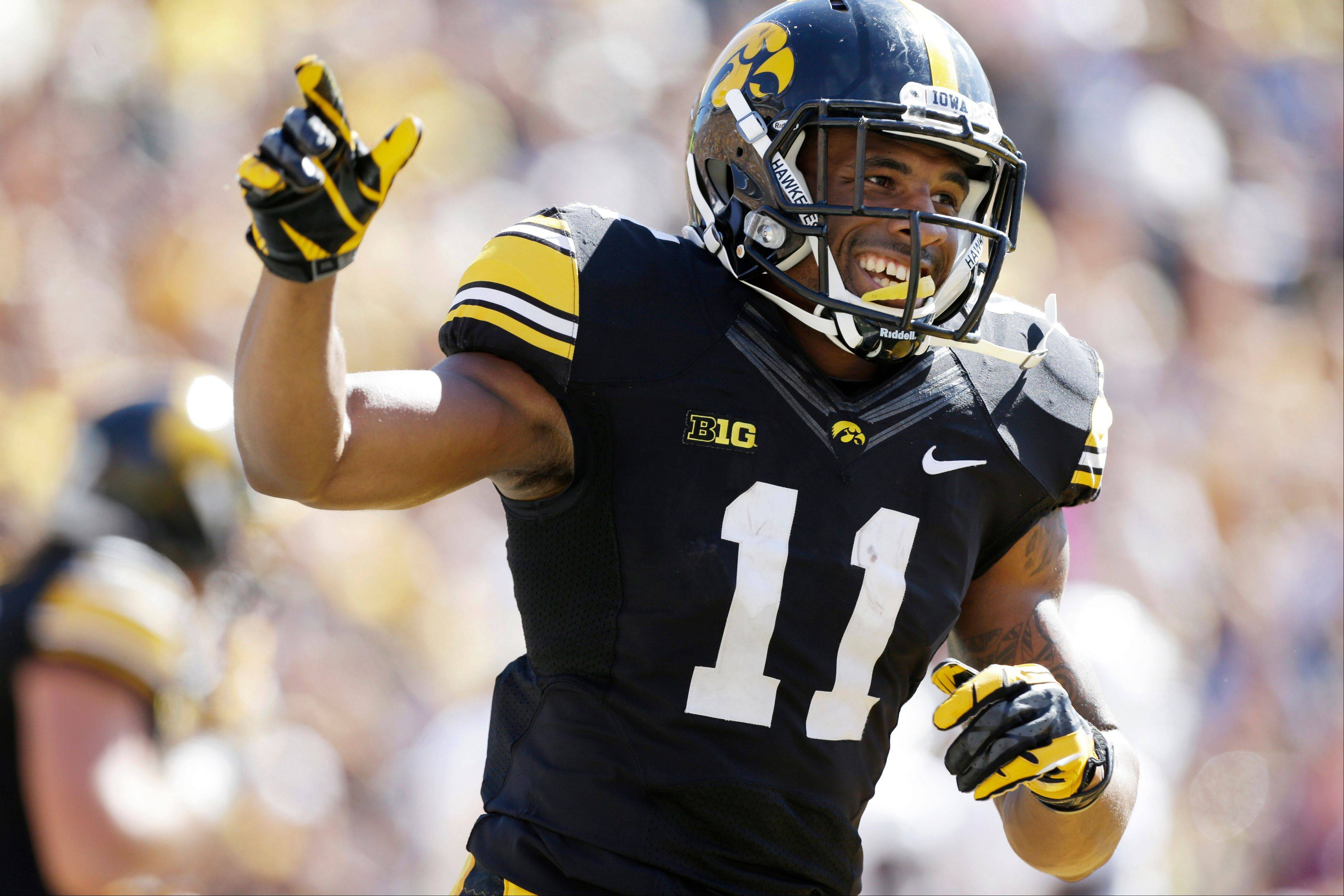Iowa's Kevonte Martin-Manley celebrates after returning a punt 63-yards for a touchdown during the first half of an NCAA college football game against Western Michigan, Saturday, Sept. 21, 2013, in Iowa City, Iowa. Martin-Manley returned two punts for touchdowns in the game as Iowa won 59-3.