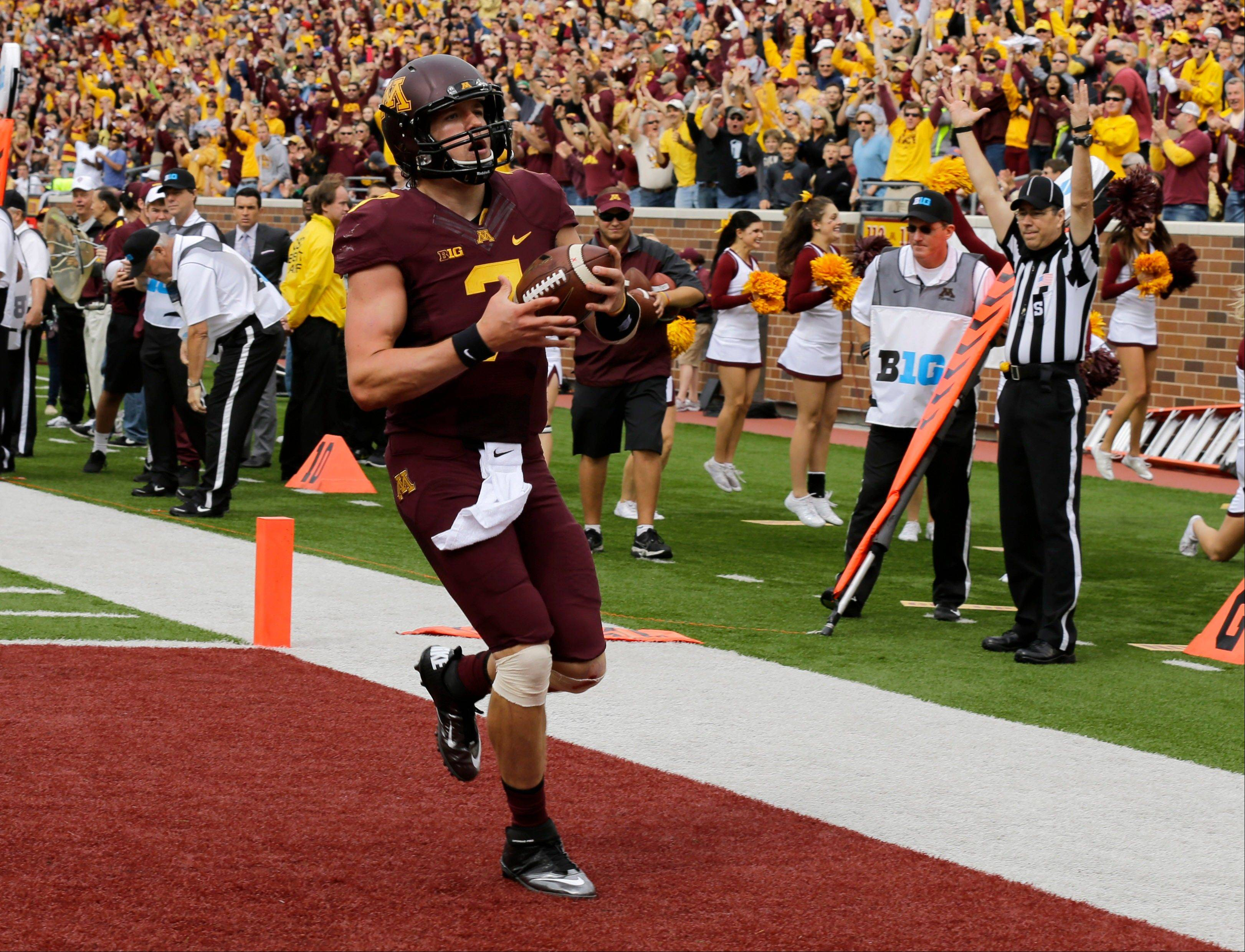 Minnesota quarterback Mitch Leidner (7) carries the ball into the end zone for a touchdown during the first quarter of an NCAA college football game against San Jose State in Minneapolis, Saturday, Sept. 21, 2013.