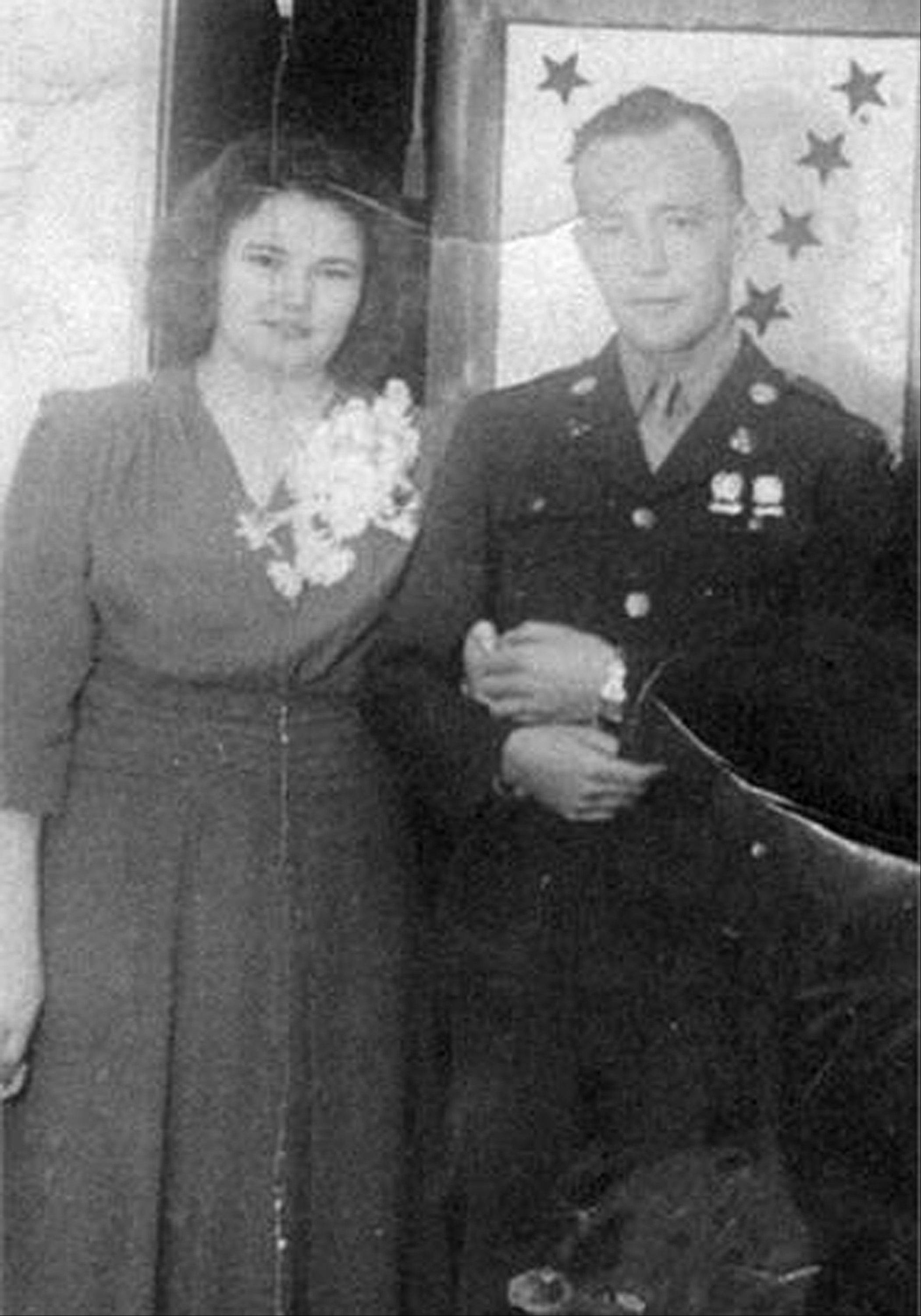 In this undated family photo provided by Kevin Smith is a wedding picture of Pfc. John Farrell Eddington and his wife, Helen. Seven decades after the Missouri soldier died in World War II, Peggy Smith, the daughter he never met is about to get his Purple Heart medal, along with the emotional letter her father wrote just weeks after her birth, at a ceremony Saturday, Sept. 21, 2013, in Dayton, Nev.