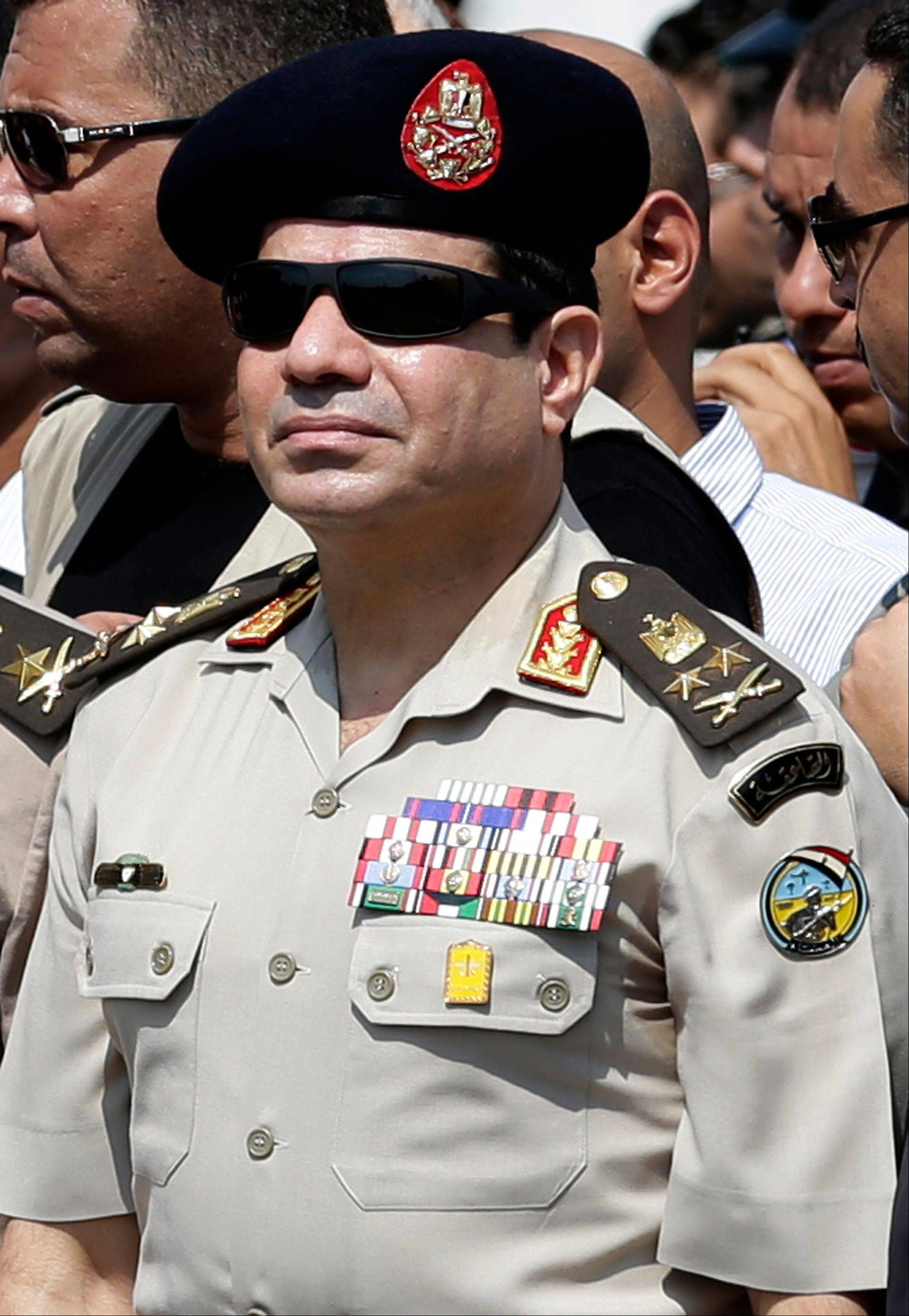 Egypt's Defense Minister Gen. Abdel-Fattah el-Sissi attends the funeral of Giza Police Gen. Nabil Farrag in Cairo, Egypt, Friday.