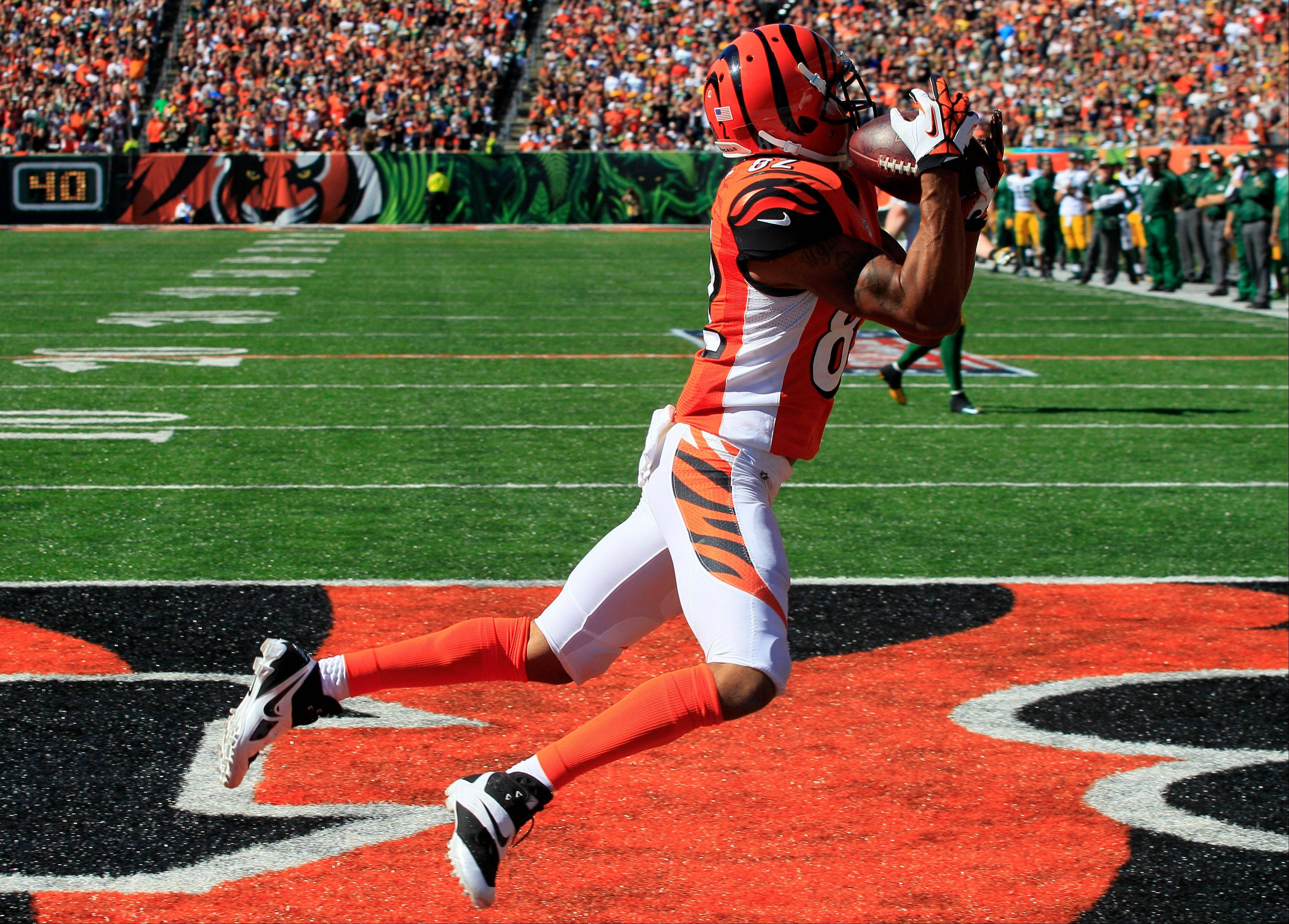 Cincinnati Bengals wide receiver Marvin Jones catches an 11-yard touchdown pass against the Green Bay Packers in the second half of an NFL football game, Sunday, Sept. 22, 2013, in Cincinnati.