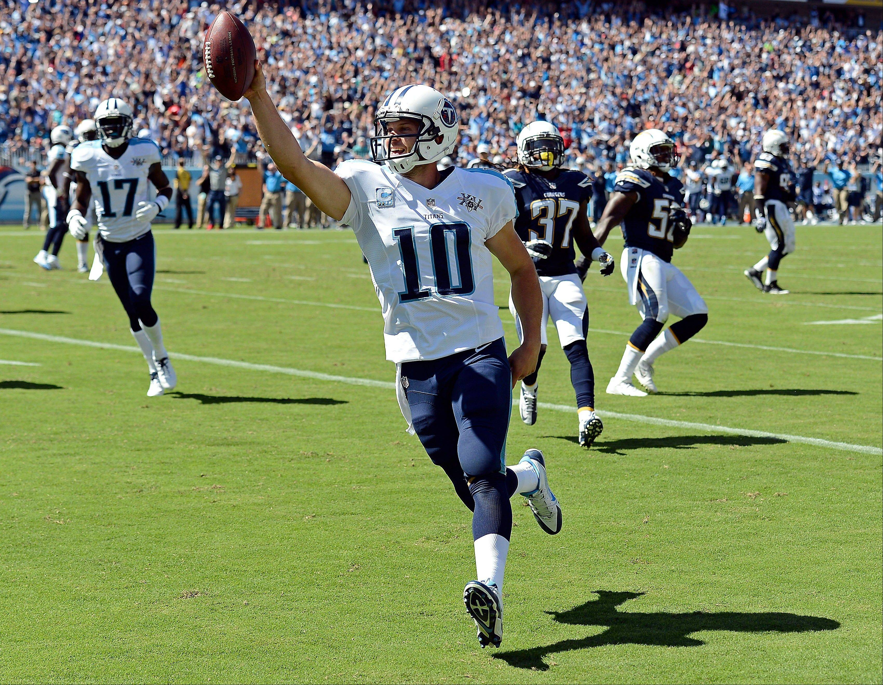 Tennessee Titans quarterback Jake Locker (10) celebrates as he scores a touchdown on a 7-yard run against the San Diego Chargers in the second quarter of an NFL football game on Sunday, Sept. 22, 2013, in Nashville, Tenn.