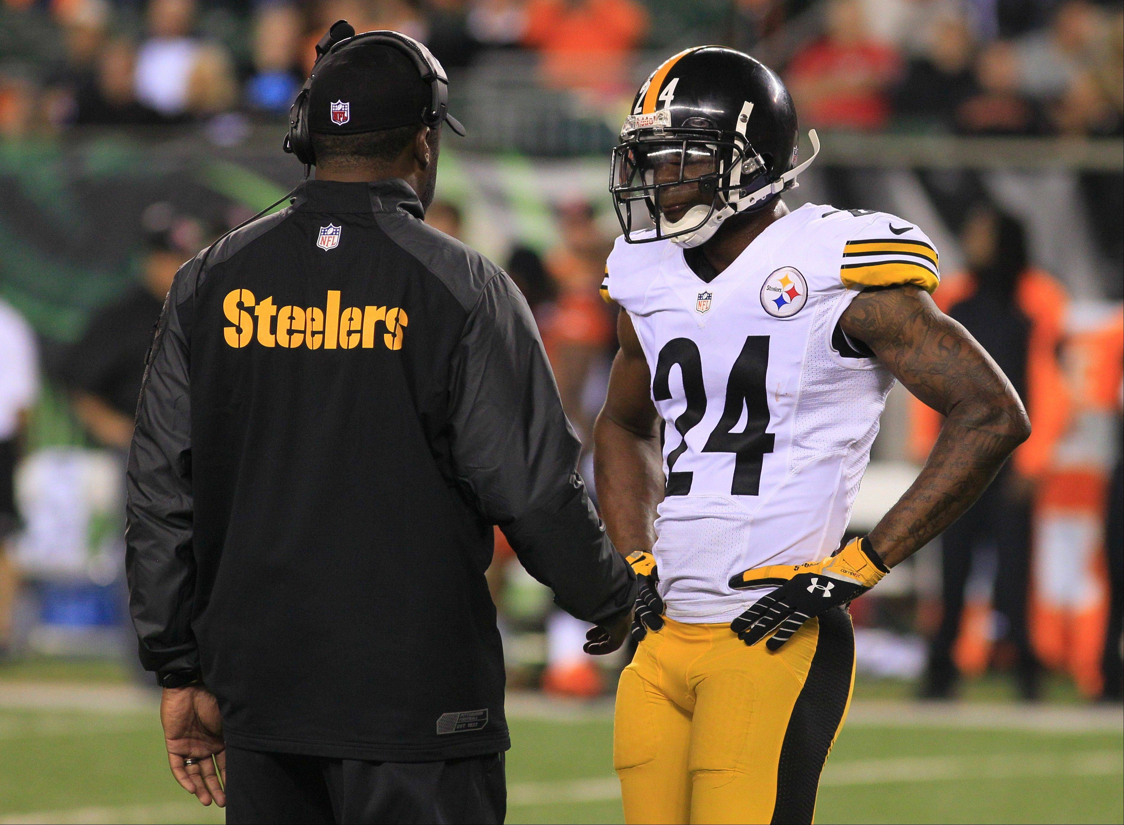 Pittsburgh Steelers head coach Mike Tomlin talks with cornerback Ike Taylor (24) in the second half of an NFL football game against the Cincinnati Bengals, Monday, Sept. 16, 2013, in Cincinnati. (AP Photo/Tom Uhlman)