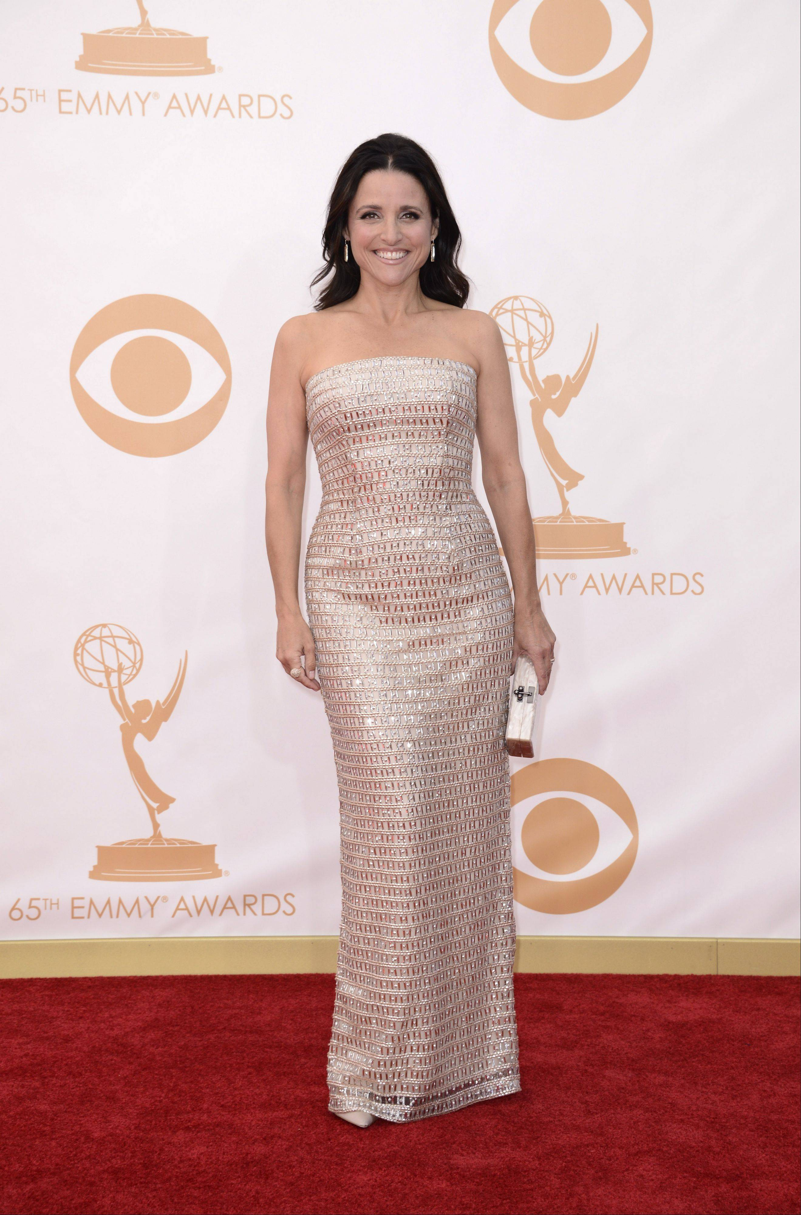 Julia Louis-Dreyfus, wearing Monique Lhuiller, arrives at the 65th Primetime Emmy Awards at Nokia Theatre on Sunday in Los Angeles.