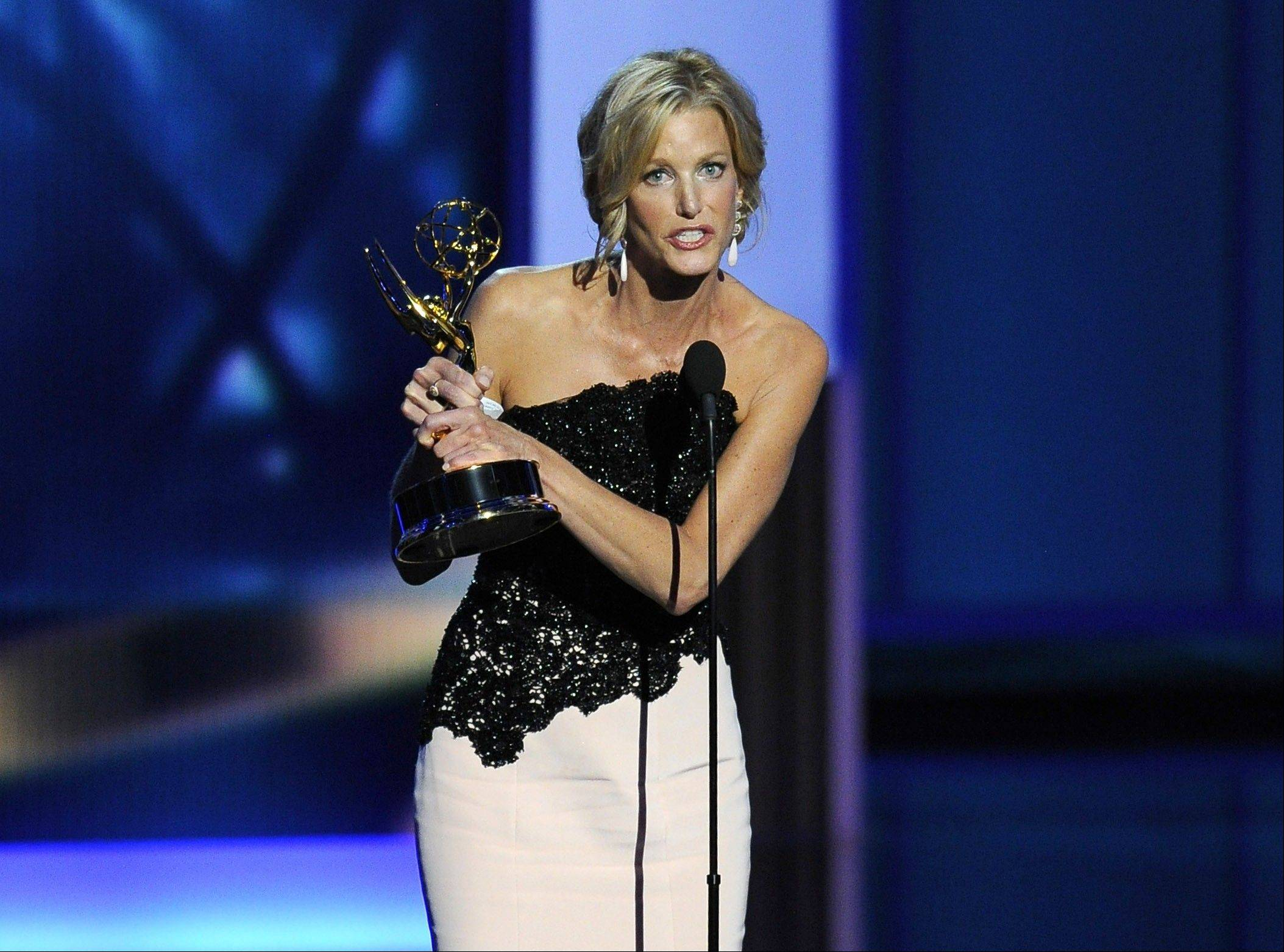 "Anna Gunn accepts the award for outstanding supporting actress in a drama series for her role on ""Breaking Bad"" at the 65th Primetime Emmy Awards at Nokia Theatre on Sunday in Los Angeles."