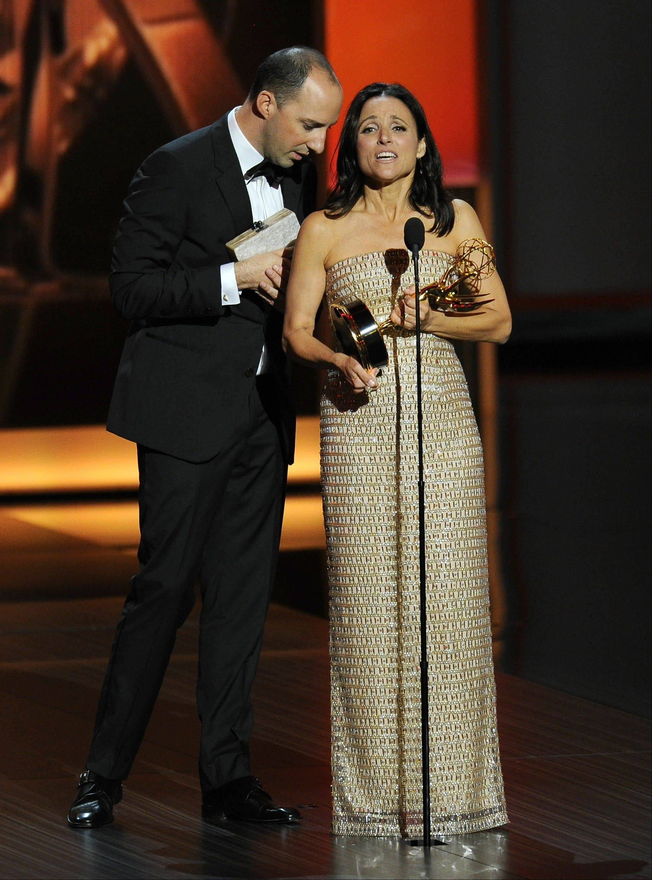"Tony Hale, left, feeds lines to Julia Louis-Dreyfus as she accepts the award for outstanding lead actress in a comedy series for her role on ""Veep"" at the 65th Primetime Emmy Awards at Nokia Theatre on Sunday in Los Angeles. """