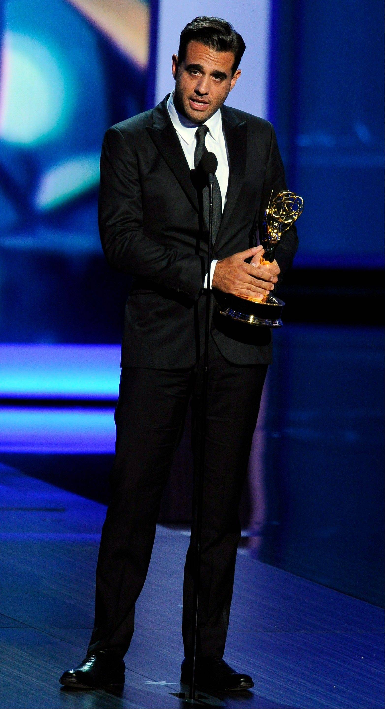 "Bobby Cannavale accepts the award for outstanding supporting actor in a drama series for his role on ""Boardwalk Empire"" at the 65th Primetime Emmy Awards at Nokia Theatre on Sunday in Los Angeles."