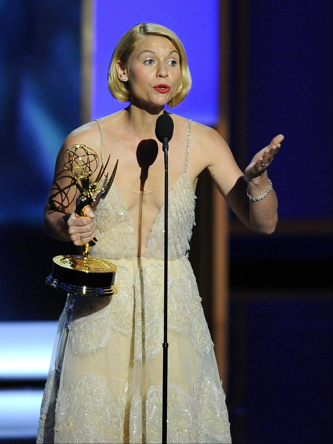 "Claire Danes accepts the award for outstanding lead actress in a drama series for her role on ""Homeland"" at the 65th Primetime Emmy Awards at Nokia Theatre on Sunday in Los Angeles."