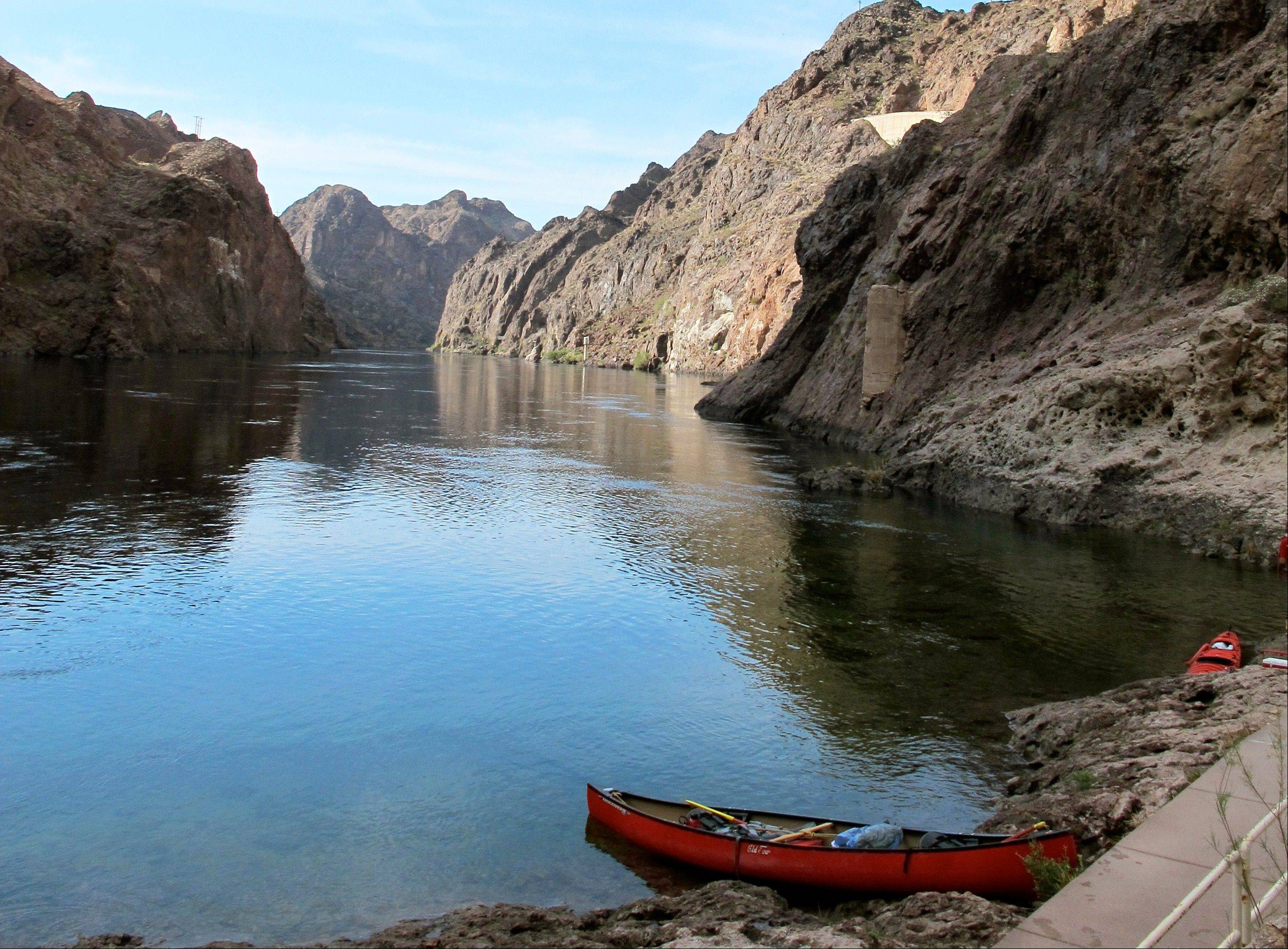The Colorado River snakes through the Black Canyon near Boulder City, Nev. Watercraft must be transported through a federal security zone near the Hoover Dam by an authorized livery service, whether you bring your own gear, rent watercraft or sign up for a guided trip.