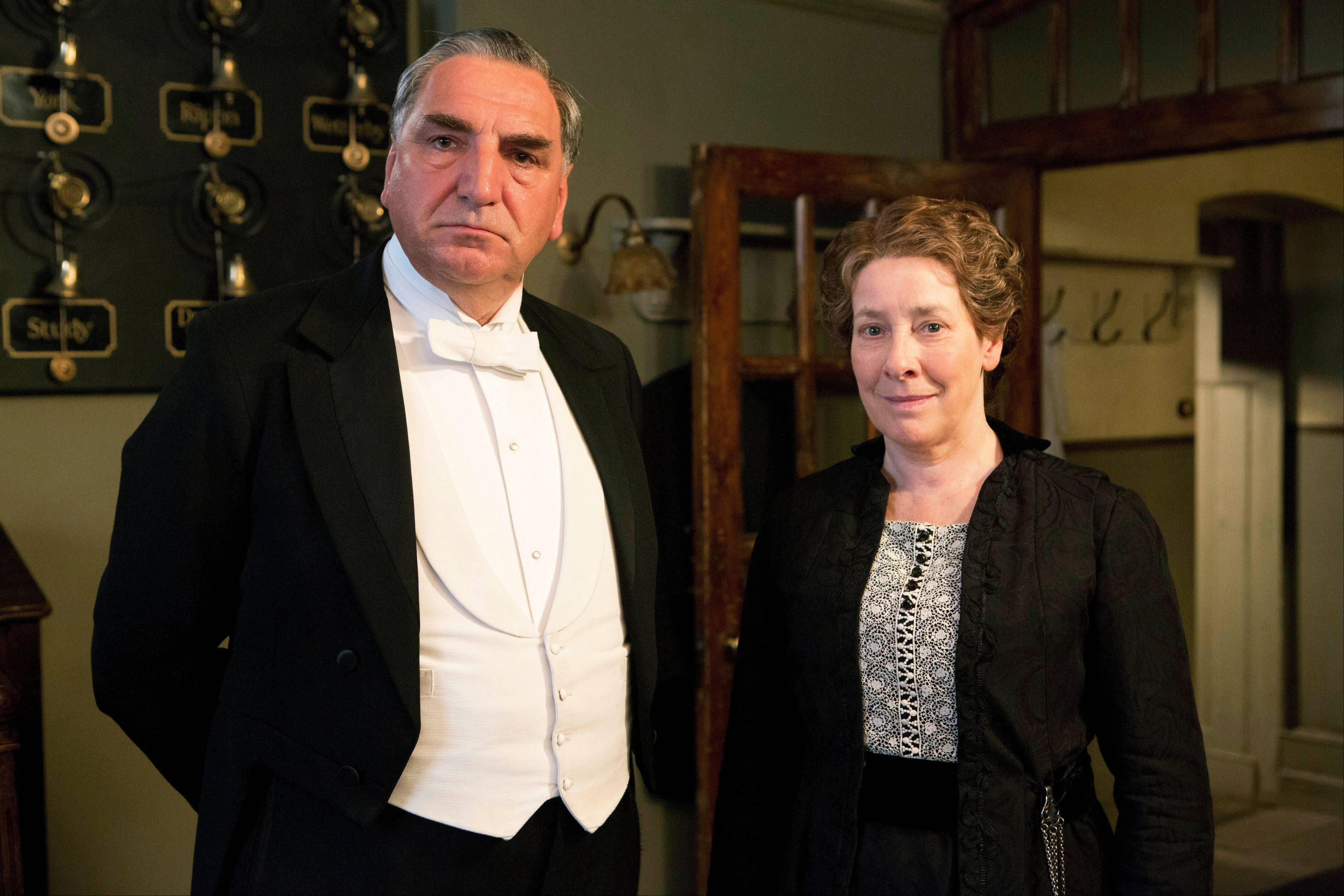 "Jim Carter is Carson and Phyllis Logan as Mrs. Hughes in ""Downton Abbey."""
