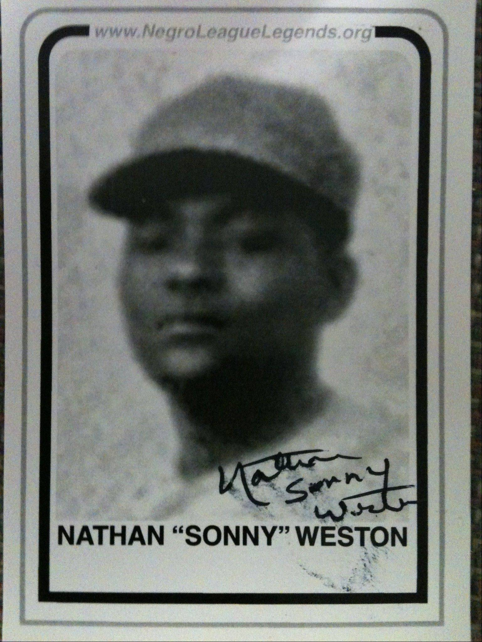"Former Negro League player Nathan ""Sonny"" Weston sold and signed copies of his trading card at Wolff's Flea Market in Rosemont Sunday."