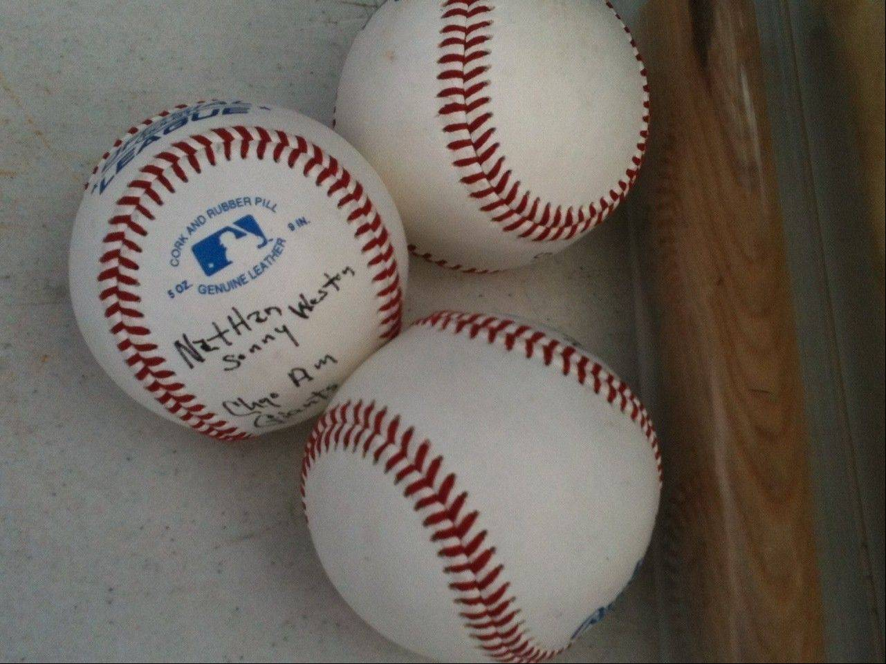 "Former Negro League player Nathan ""Sonny"" Weston autographed baseballs for fans at the Wolff's Flea Market in Rosemont Sunday."