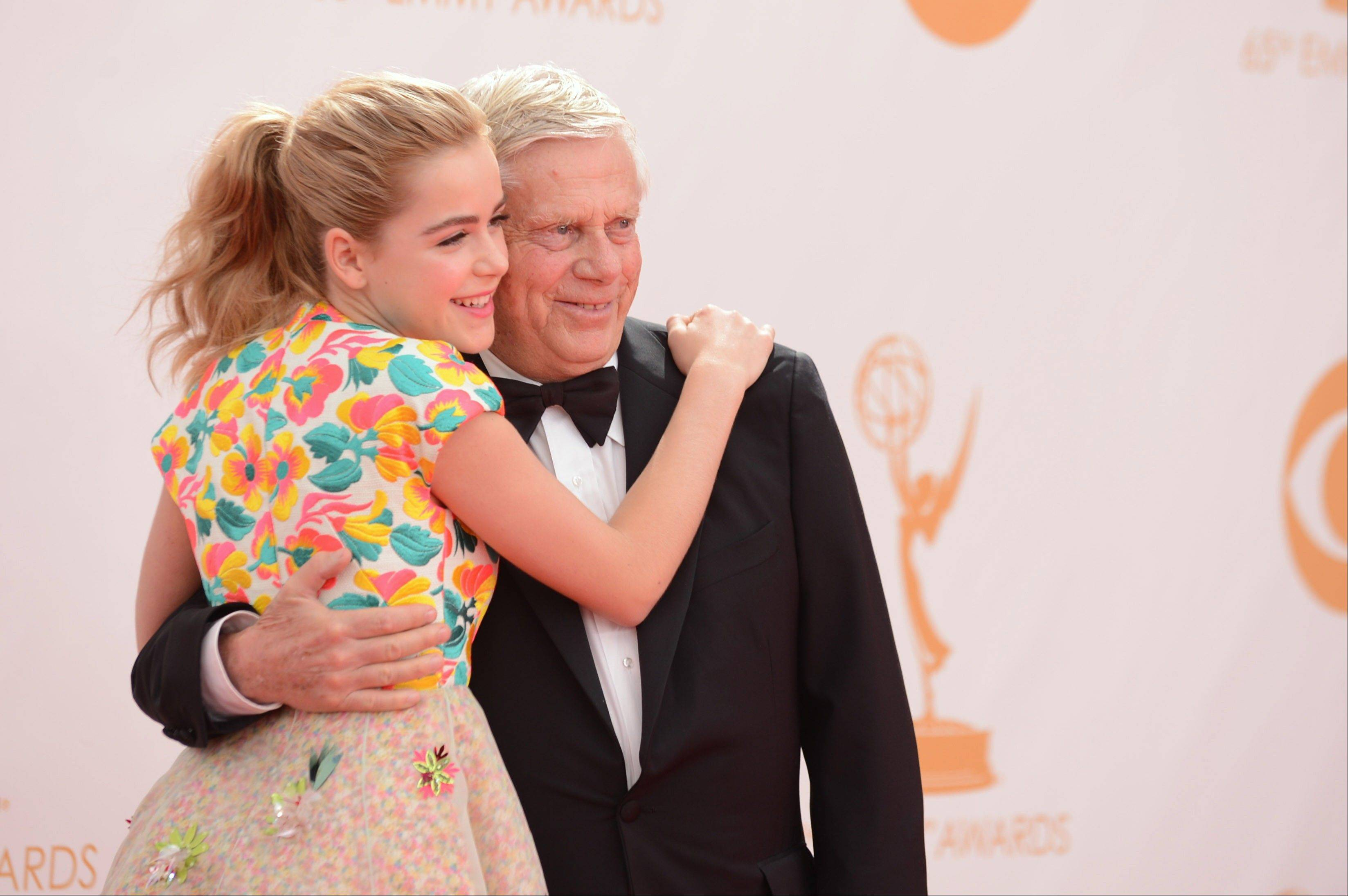 "Kiernan Shipka and Robert Morse of ""Mad Men"" arrive at the 65th Primetime Emmy Awards at Nokia Theatre on Sunday, Sept. 22, 2013, in Los Angeles."