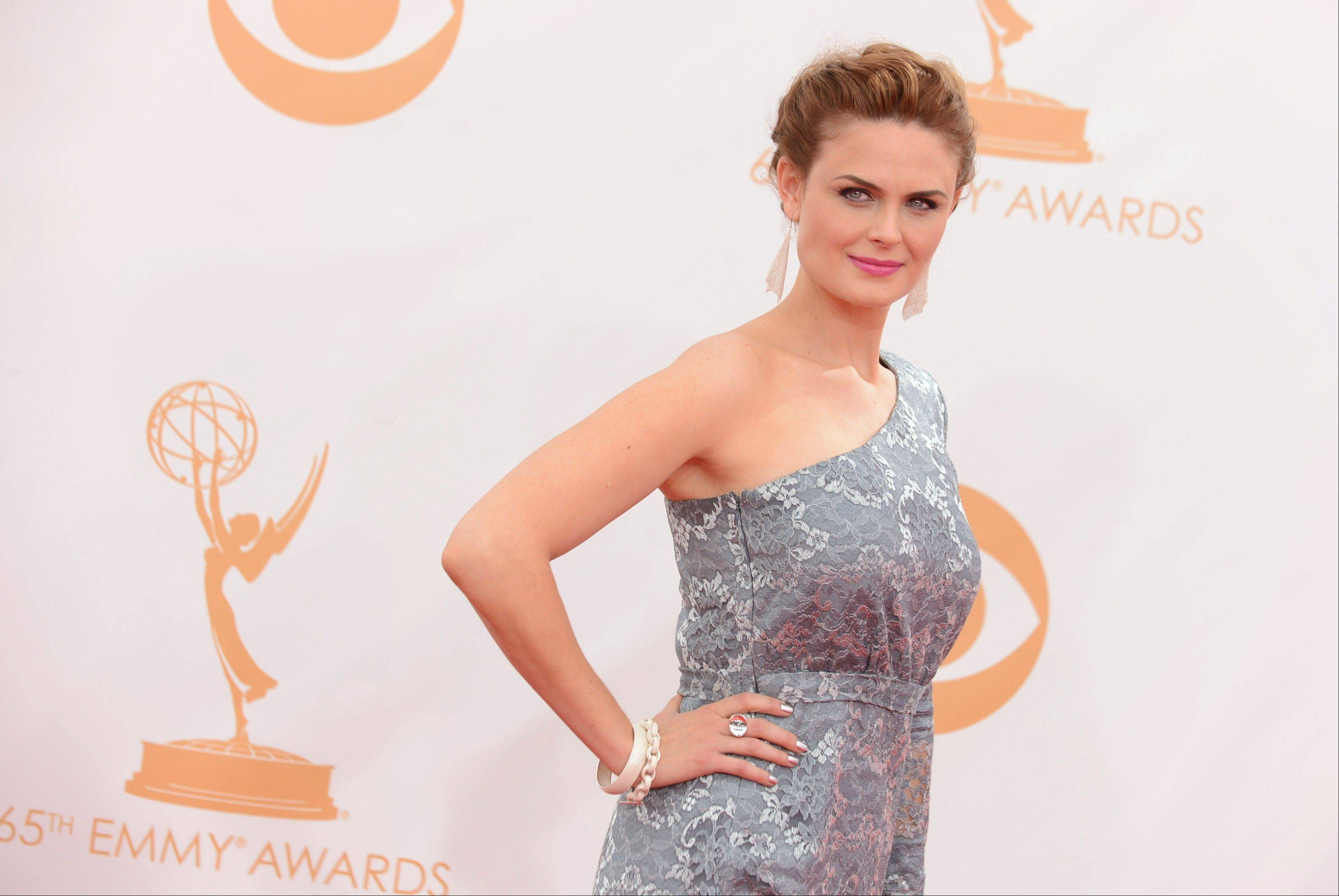 "Emily Deschanel of ""Bones"" arrives at the 65th Primetime Emmy Awards at Nokia Theatre on Sunday, Sept. 22, 2013, in Los Angeles."