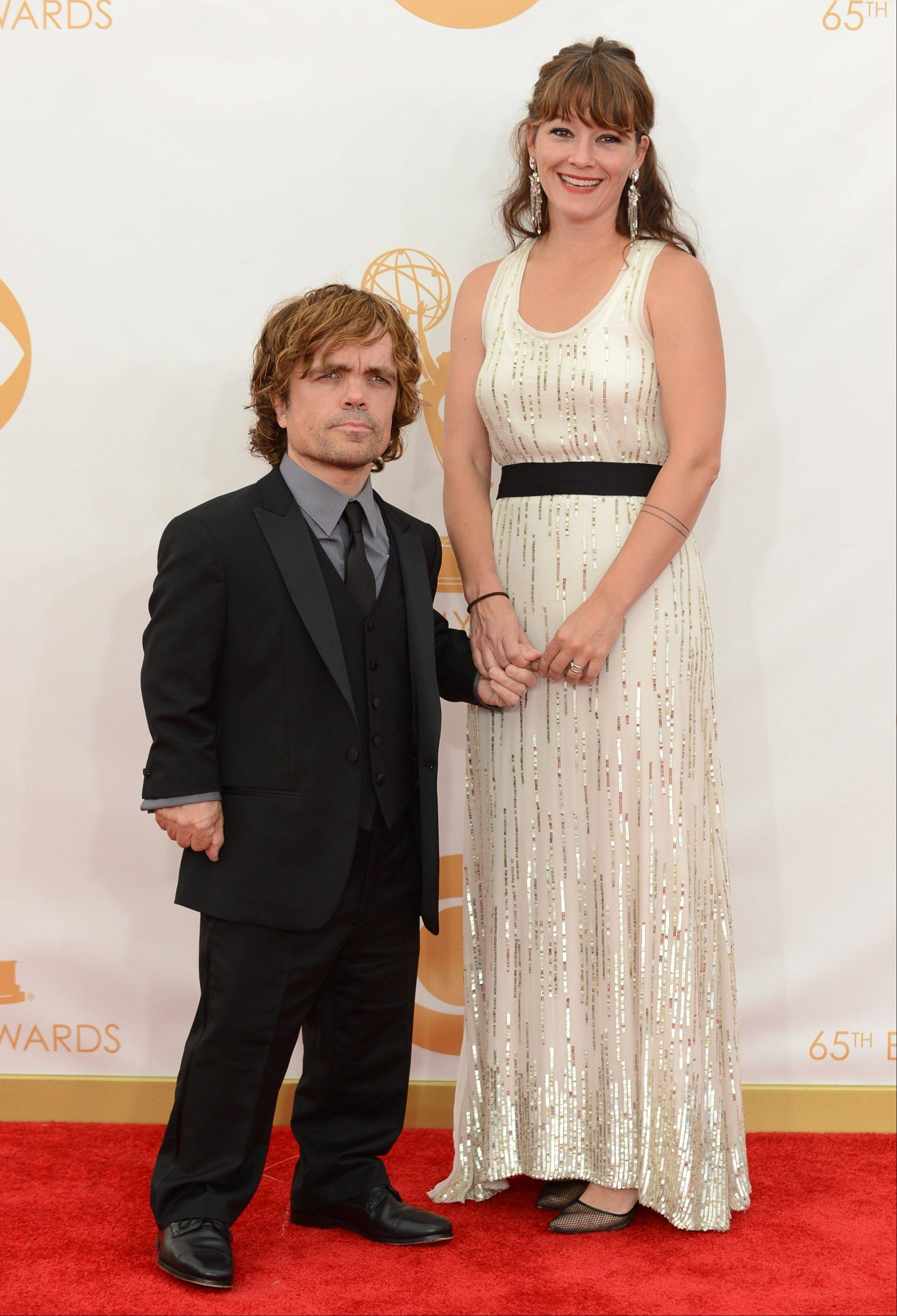 """Game of Thrones"" star Peter Dinklage, left, and his wife Erica Schmidt arrive at the 65th Primetime Emmy Awards at Nokia Theatre on Sunday Sept. 22, 2013, in Los Angeles."