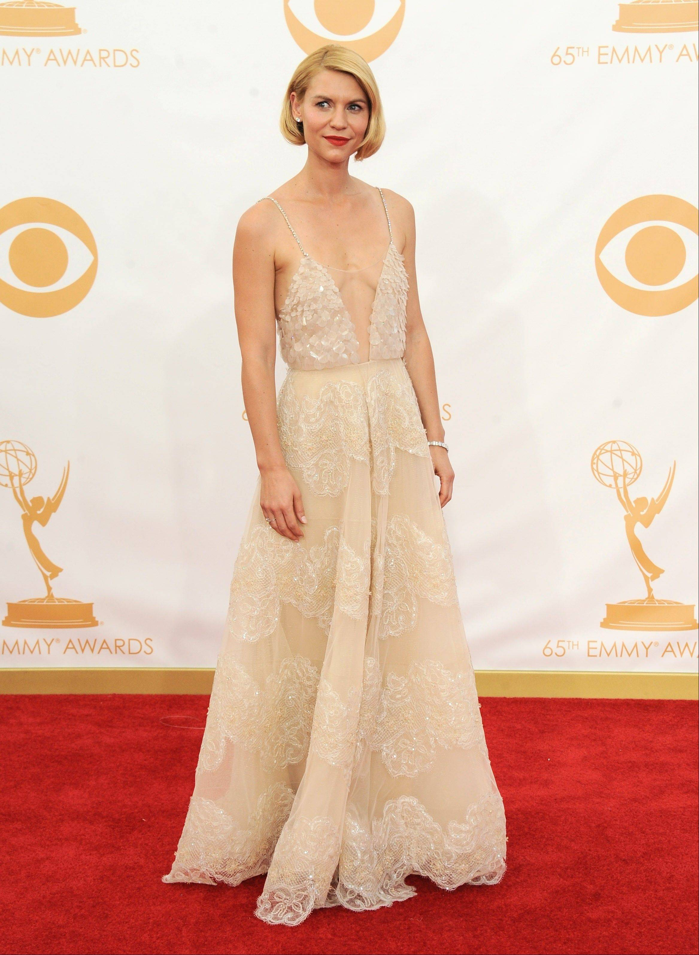 """Homeland"" star Claire Danes, wearing Atelier Versace, arrives at the 65th Primetime Emmy Awards at Nokia Theatre on Sunday Sept. 22, 2013, in Los Angeles."