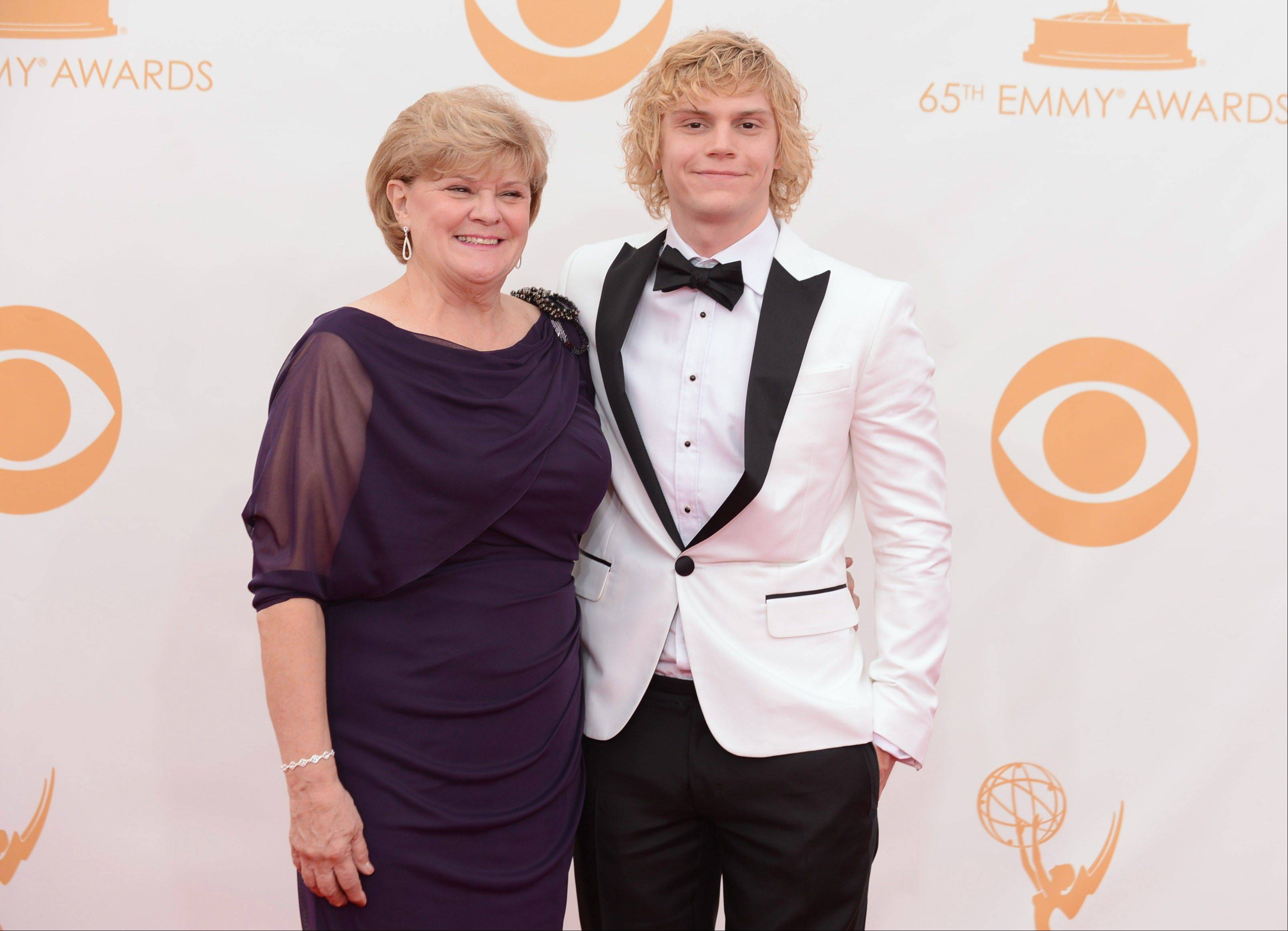 "Evan Peters of ""American Horror Story: Asylum"" and his mother arrive at the 65th Primetime Emmy Awards at Nokia Theatre on Sunday, Sept. 22, 2013, in Los Angeles."