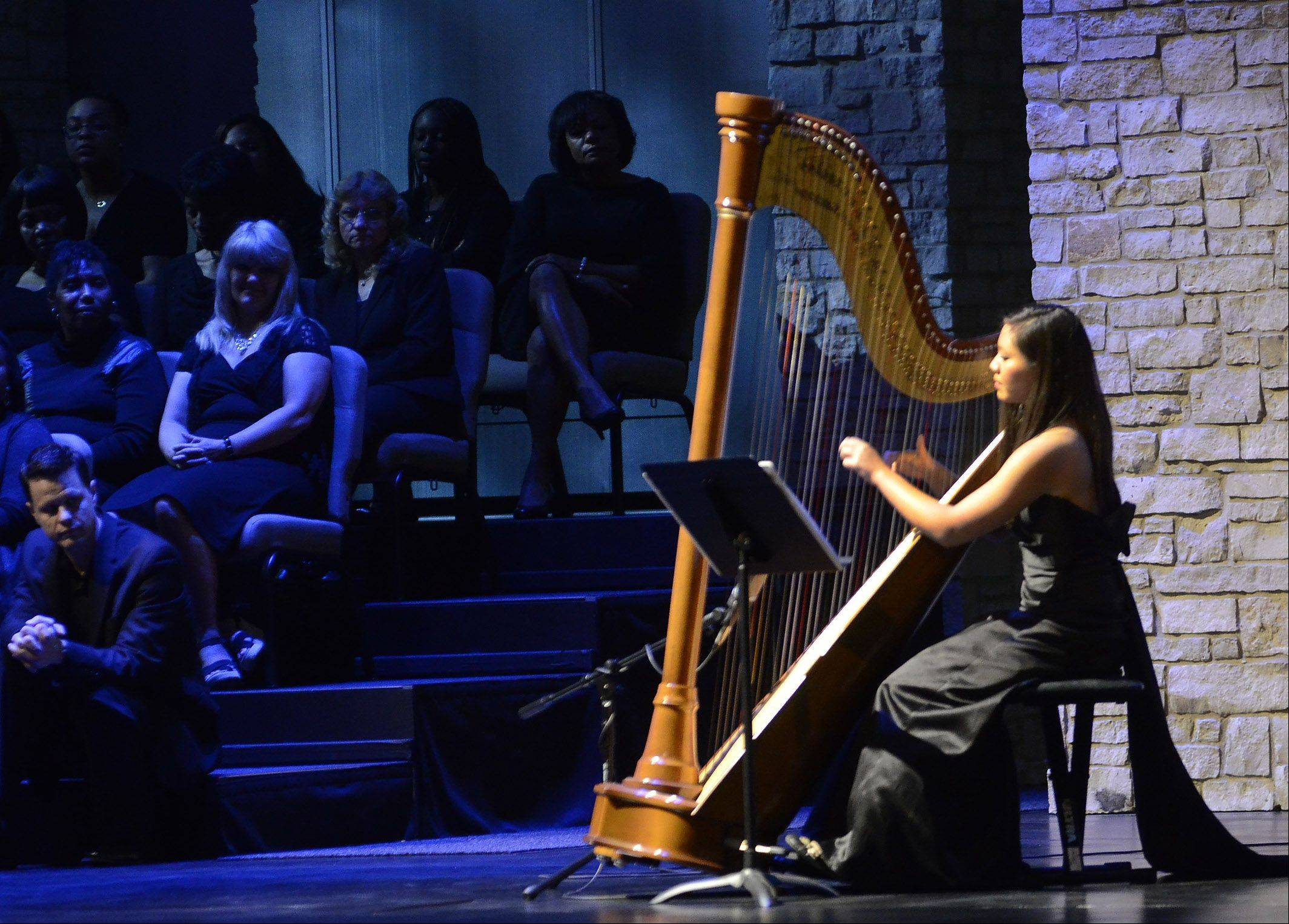 "Harp soloist Lauren Lee plays J.S. Bach's ""Prelude #1 in C"" as Calvary Church in Naperville opened its newly renovated auditorium Sunday after more than five months of construction. The choir and orchestra lead the congregation through a history of worship."