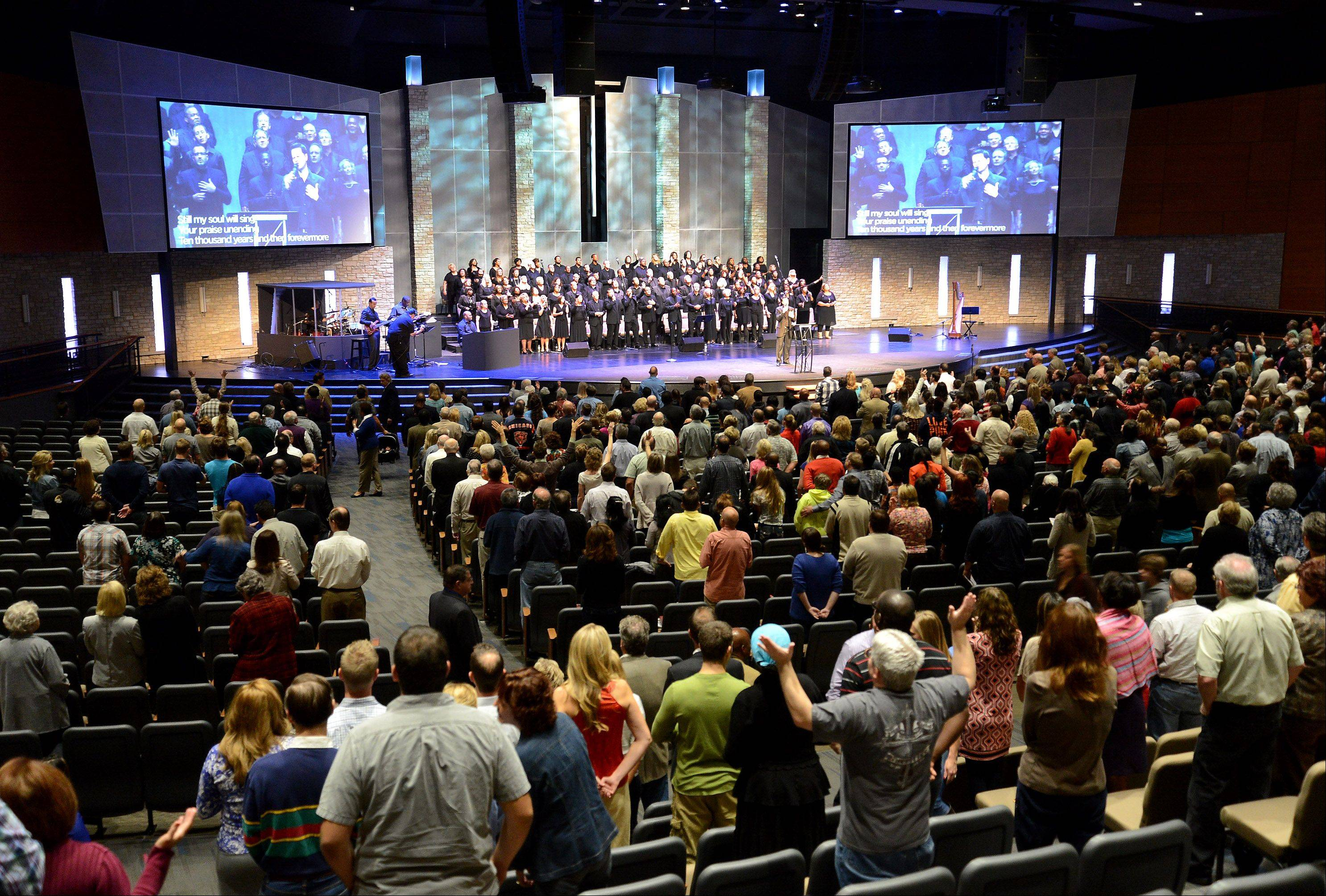 Calvary Church in Naperville opened its newly renovated auditorium Sunday after more than five months of construction. The choir and orchestra lead the congregation through a history of worship.