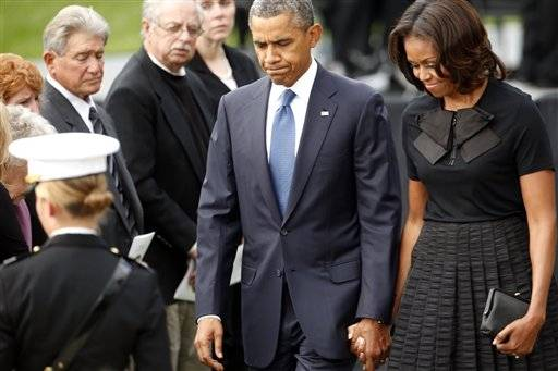 President Barack Obama and first lady Michelle Obama arrive at a memorial service Sunday for the victims of the Washington Navy�Yard shooting at Marine Barracks Washington.