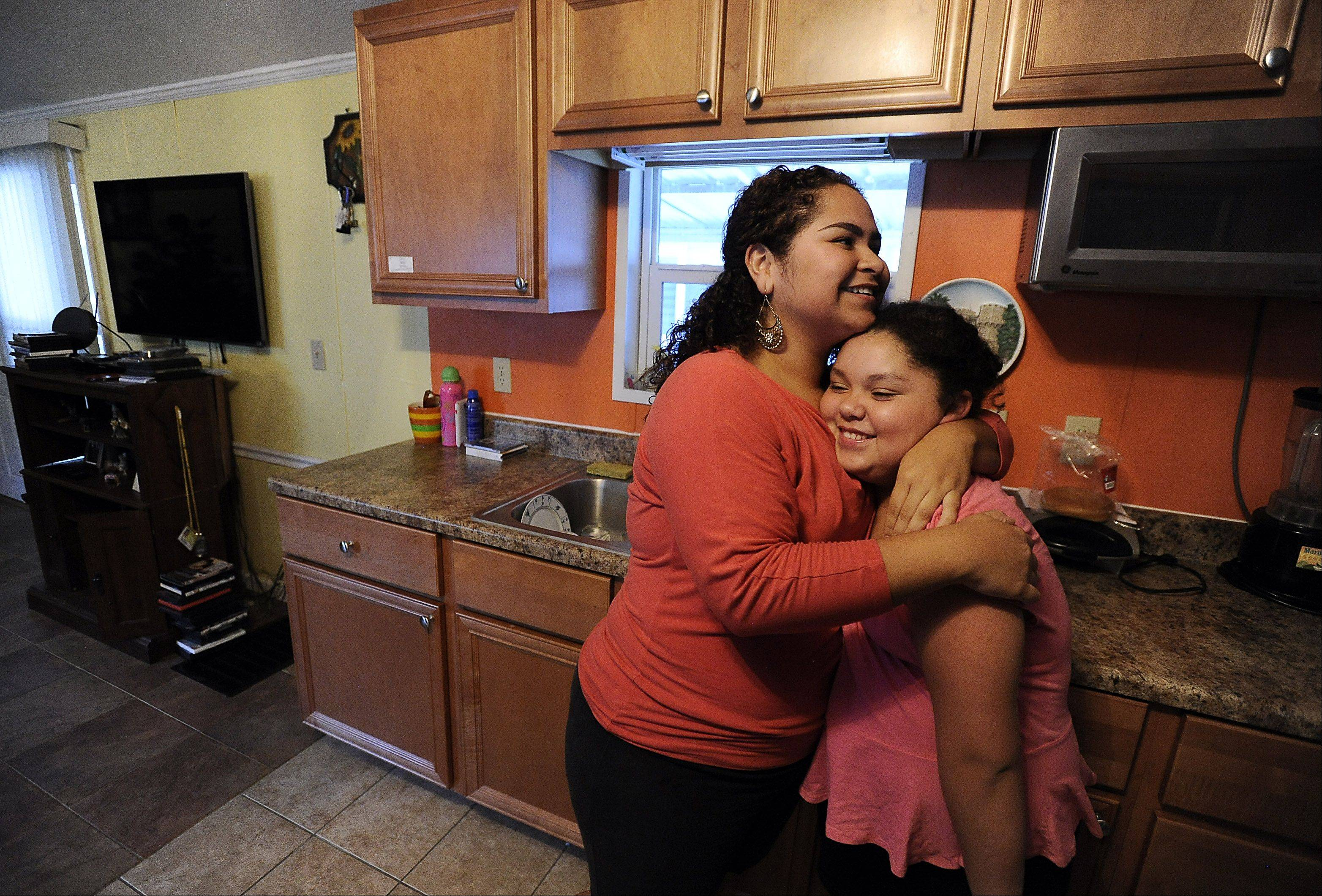 Greta Ramirez, 12, right, and her sister Karen, 22, who live near Des Plaines, were always close. They're more so in the two years since the death of their mother, Alicia Ramirez, at the hands of their father, Heriberto Ramirez, who was convicted of her murder last year.