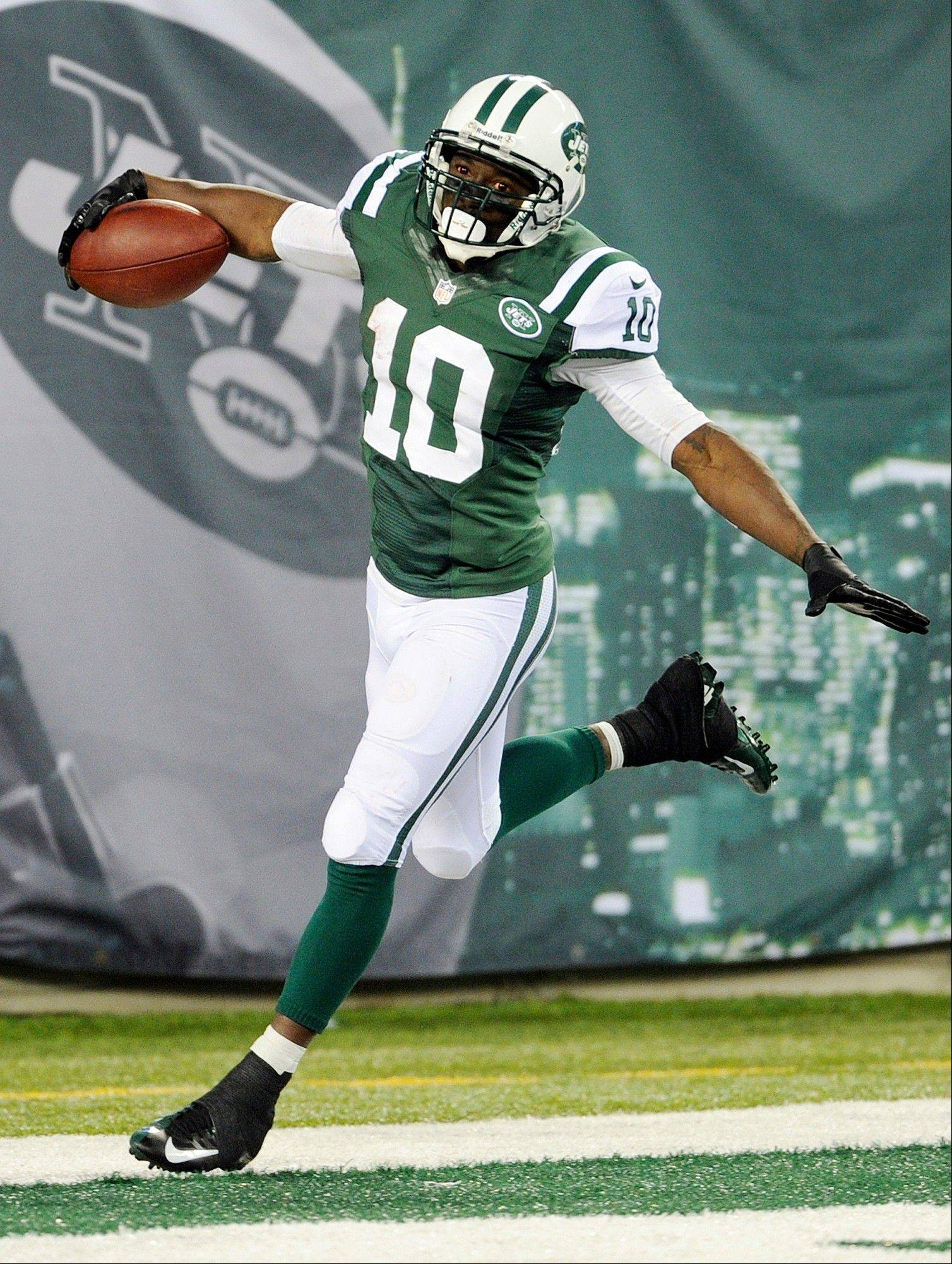 New York Jets wide receiver Santonio Holmes (10) celebrates after scoring a touchdown during the second half of an NFL football game against the Buffalo Bills Sunday, Sept. 22, 2013, in East Rutherford, N.J.