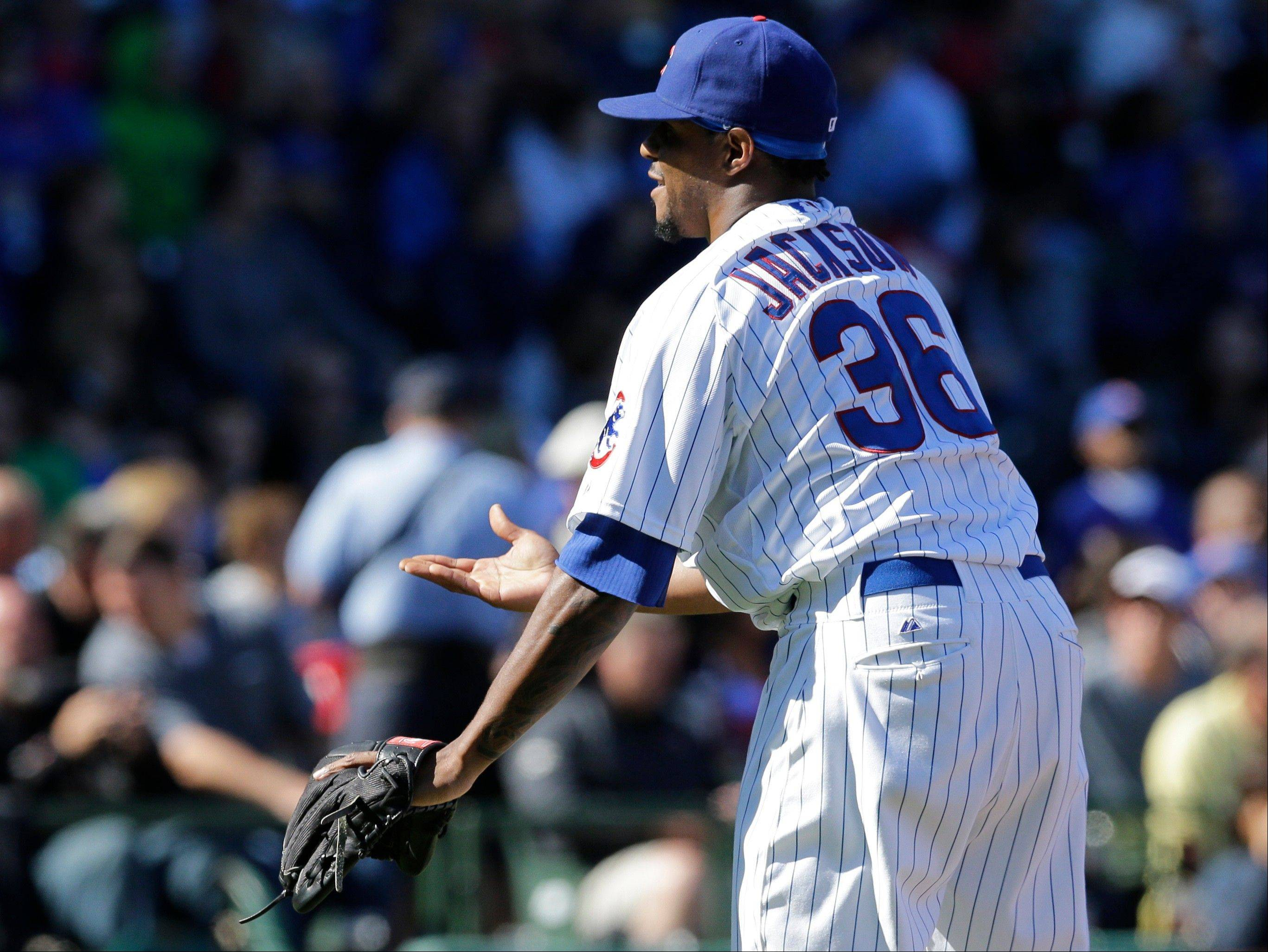 Cubs starter Edwin Jackson reacts to catcher Dioner Navarro after the Braves' Andrelton Simmons hit a solo home in the fourth inning Sunday at Wrigley Field.