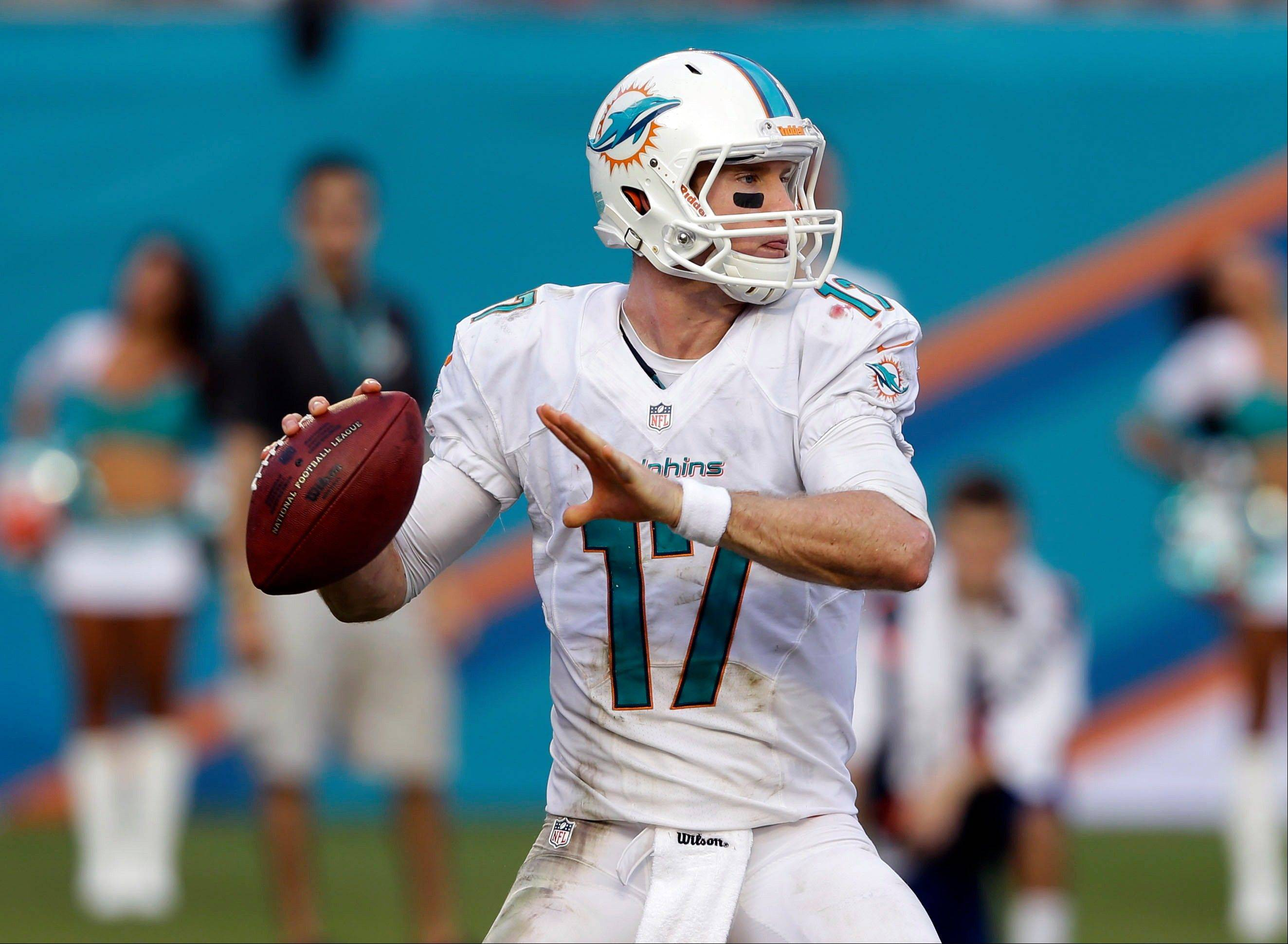 Miami Dolphins quarterback Ryan Tannehill (17) looks to pass during the second half of an NFL football game against the Atlanta Falcons, Sunday, Sept. 22, 2013, in Miami Gardens, Fla. The Dolphins defeated the Falcons 27-13.
