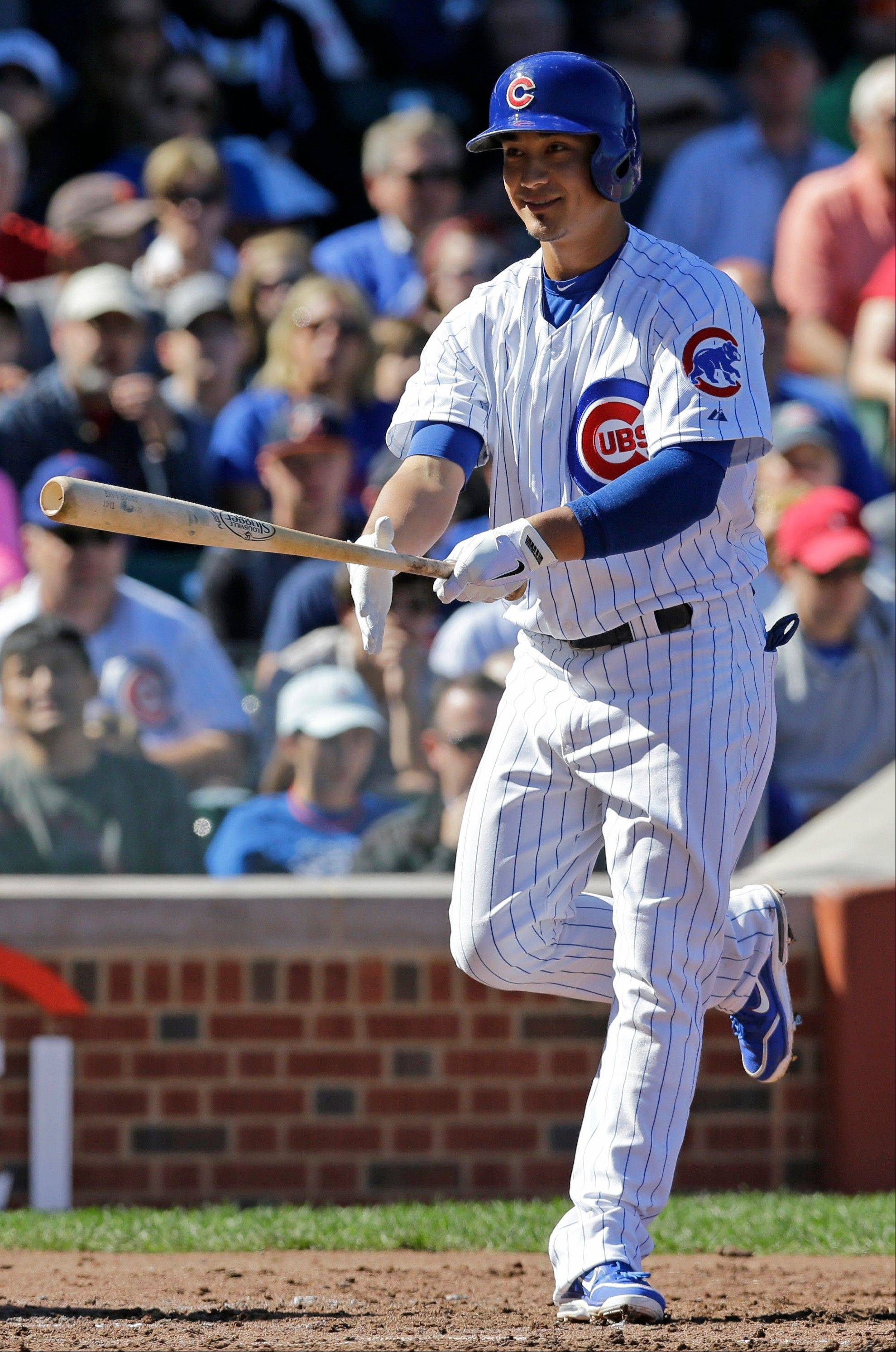 Chicago Cubs hitter Darwin Barney reacts after striking out during the second inning of a baseball game against the Atlanta Braves, Sunday, Sept. 22, 2013, in Chicago.
