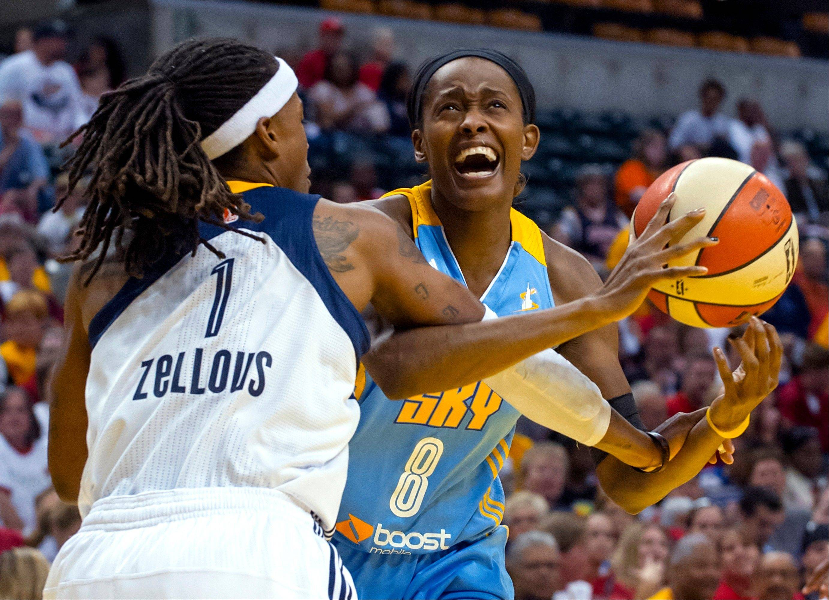 Chicago Sky forward Swin Cash (8) is fouled by Indiana Fever guard Shavonte Zellous (1) on her way to the basket during the first half of Game 2 of the WNBA basketball Eastern Conference semifinal series, Sunday, Sept. 22, 2013, in Indianapolis.