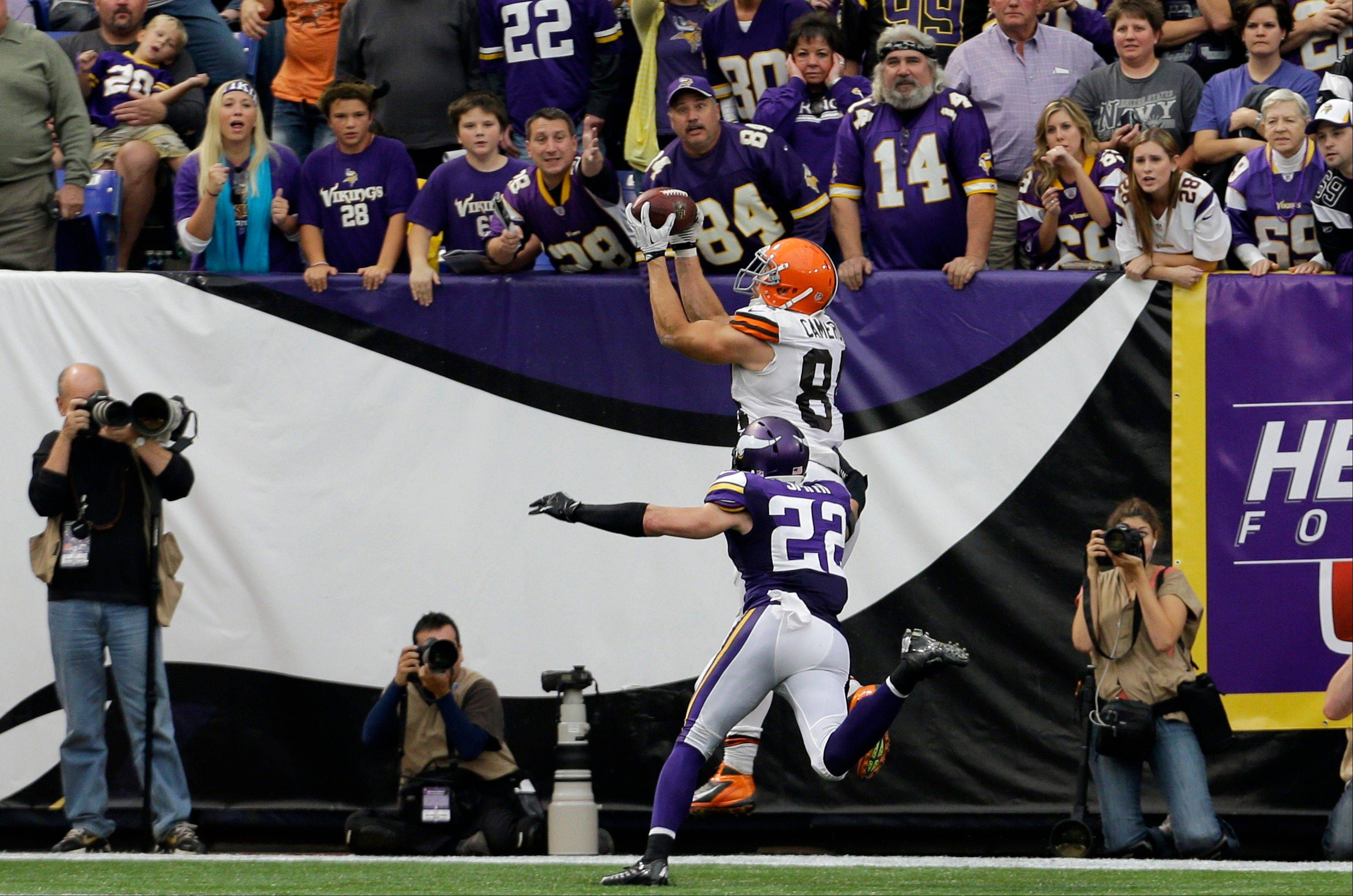 Cleveland Browns tight end Jordan Cameron, top, catches a 7-yard touchdown pass over Minnesota Vikings free safety Harrison Smith (22) during the second half of an NFL football game Sunday, Sept. 22, 2013, in Minneapolis. The Browns won 31-27.