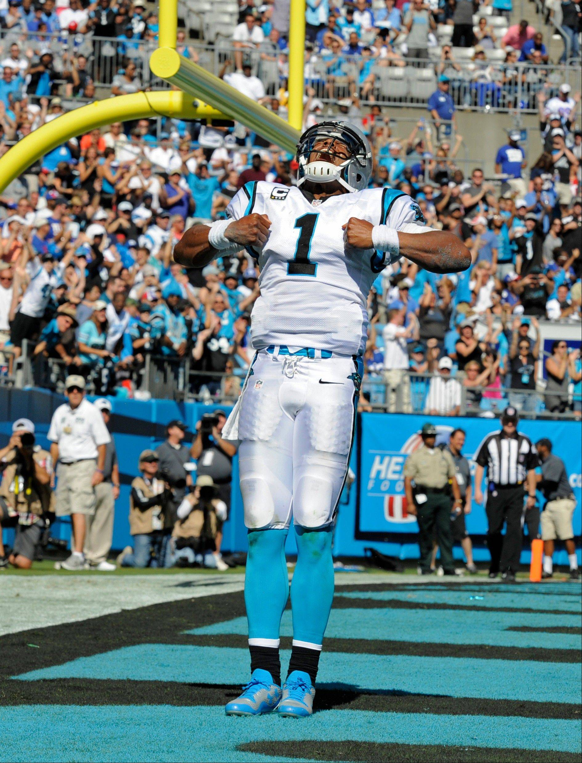 Carolina Panthers' Cam Newton (1) celebrates his touchdown run against the New York Giants during the second half of an NFL football game in Charlotte, N.C., Sunday, Sept. 22, 2013.