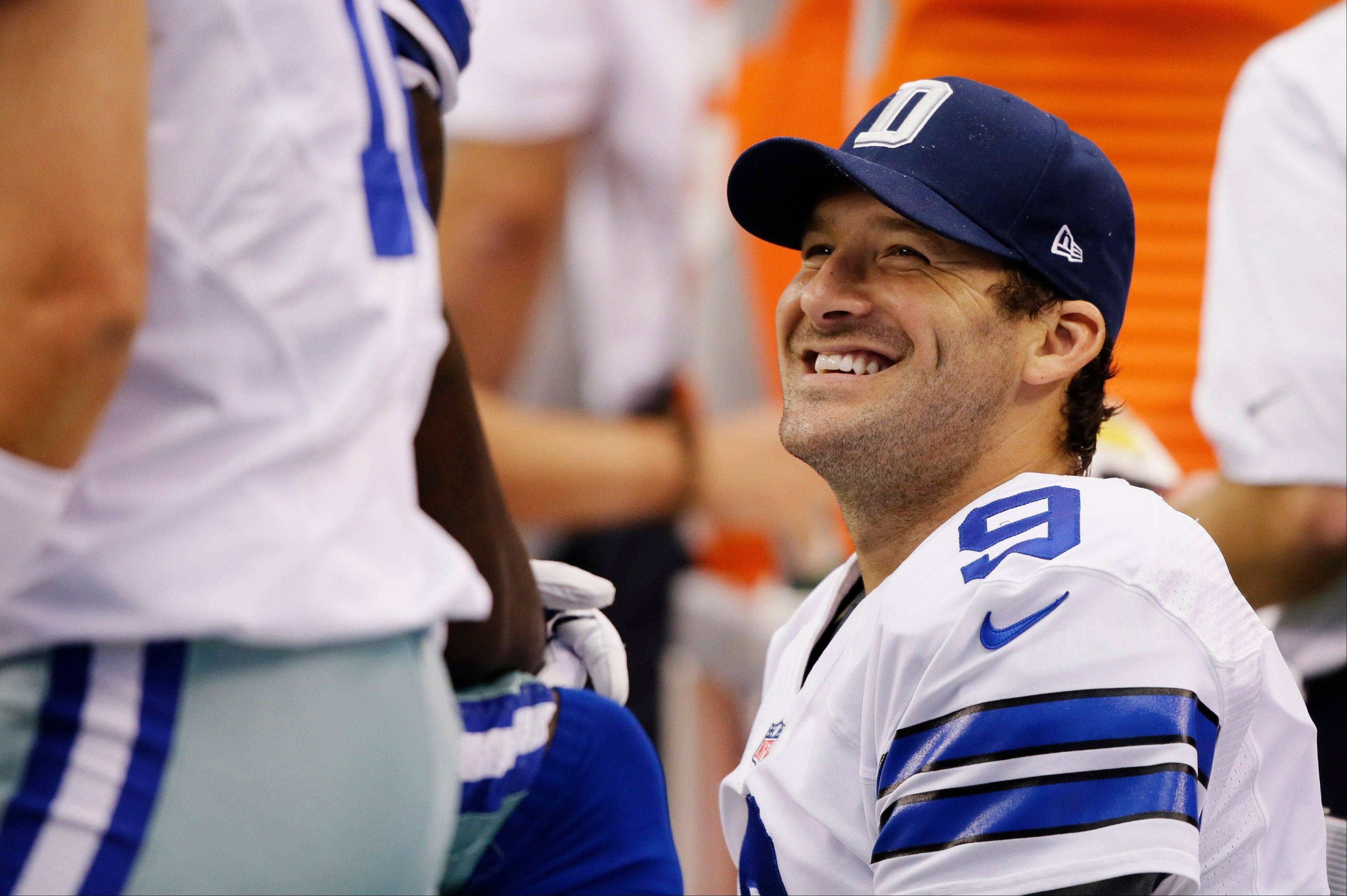 Dallas Cowboys quarterback Tony Romo (9) talks with teammates on the sideline during the fourth quarter of a NFL football game against the St. Louis Rams, Sunday, Sept. 22, 2013, in Arlington, Texas. The Cowboys won 31-7.