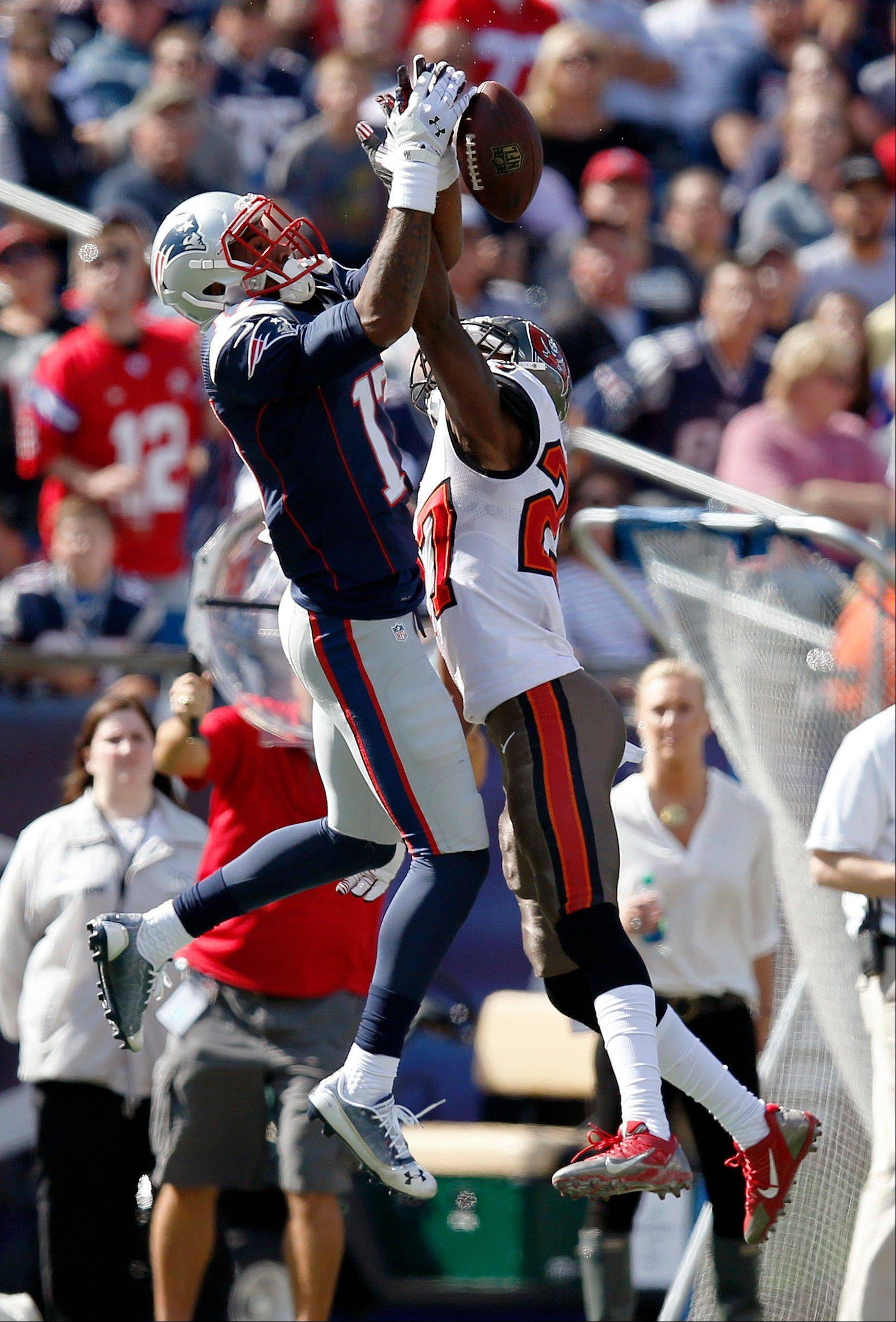 Tampa Bay Buccaneers cornerback Johnthan Banks (27) breaks up a pass intended for New England Patriots wide receiver Aaron Dobson (17) in the first half of an NFL football game Sunday, Sept. 22, 2013, in Foxborough, Mass.