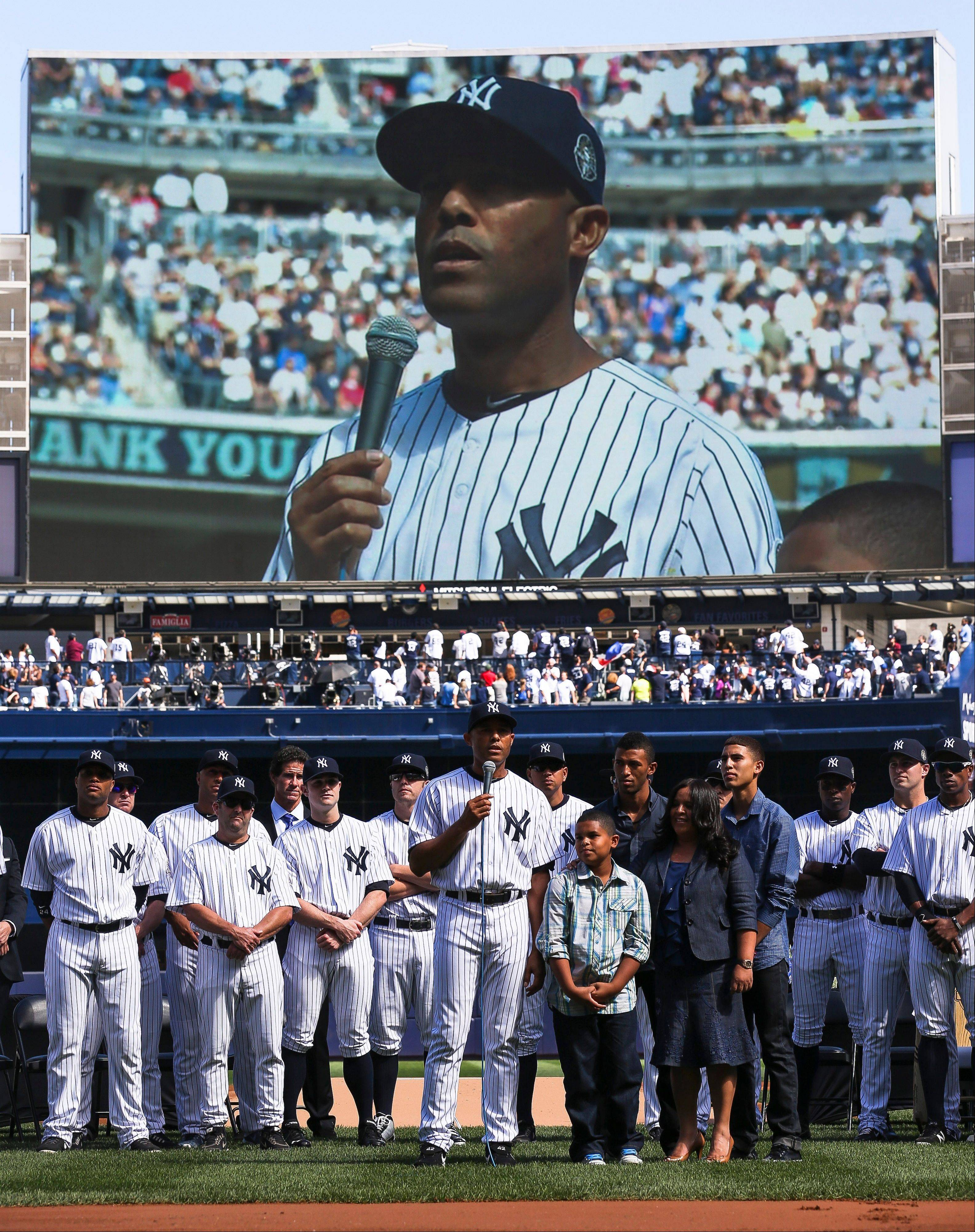 New York Yankees relief pitcher Mariano Rivera (42) addresses the crowd as he is honored in a pregam