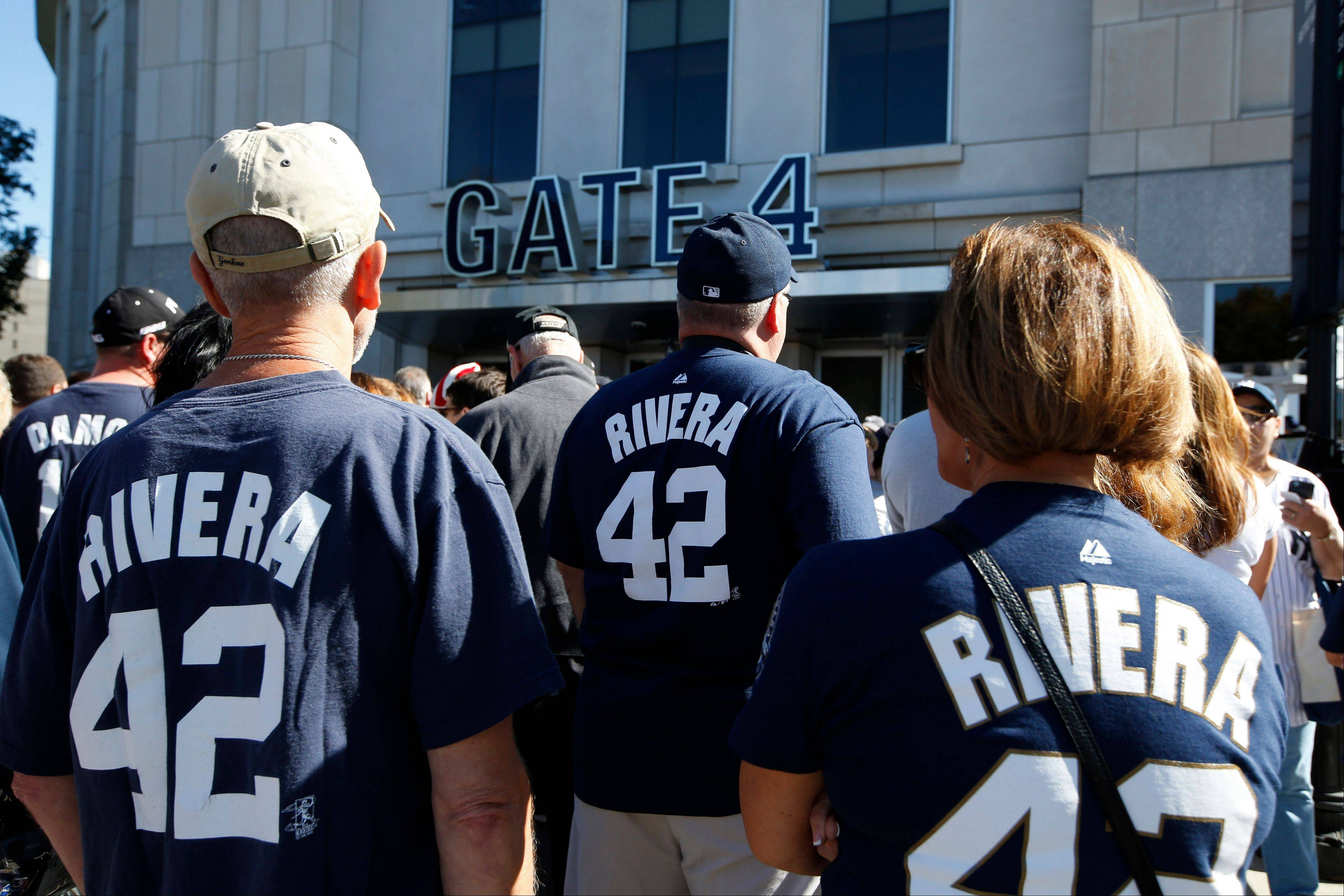 Fans of New York Yankees relief pitcher Mariano Rivera line up outside Yankee Stadium before their baseball game against the San Francisco Giants, Sunday, Sept. 22, 2013, in New York. The Yankees plan to honor Rivera in a retirement ceremony.