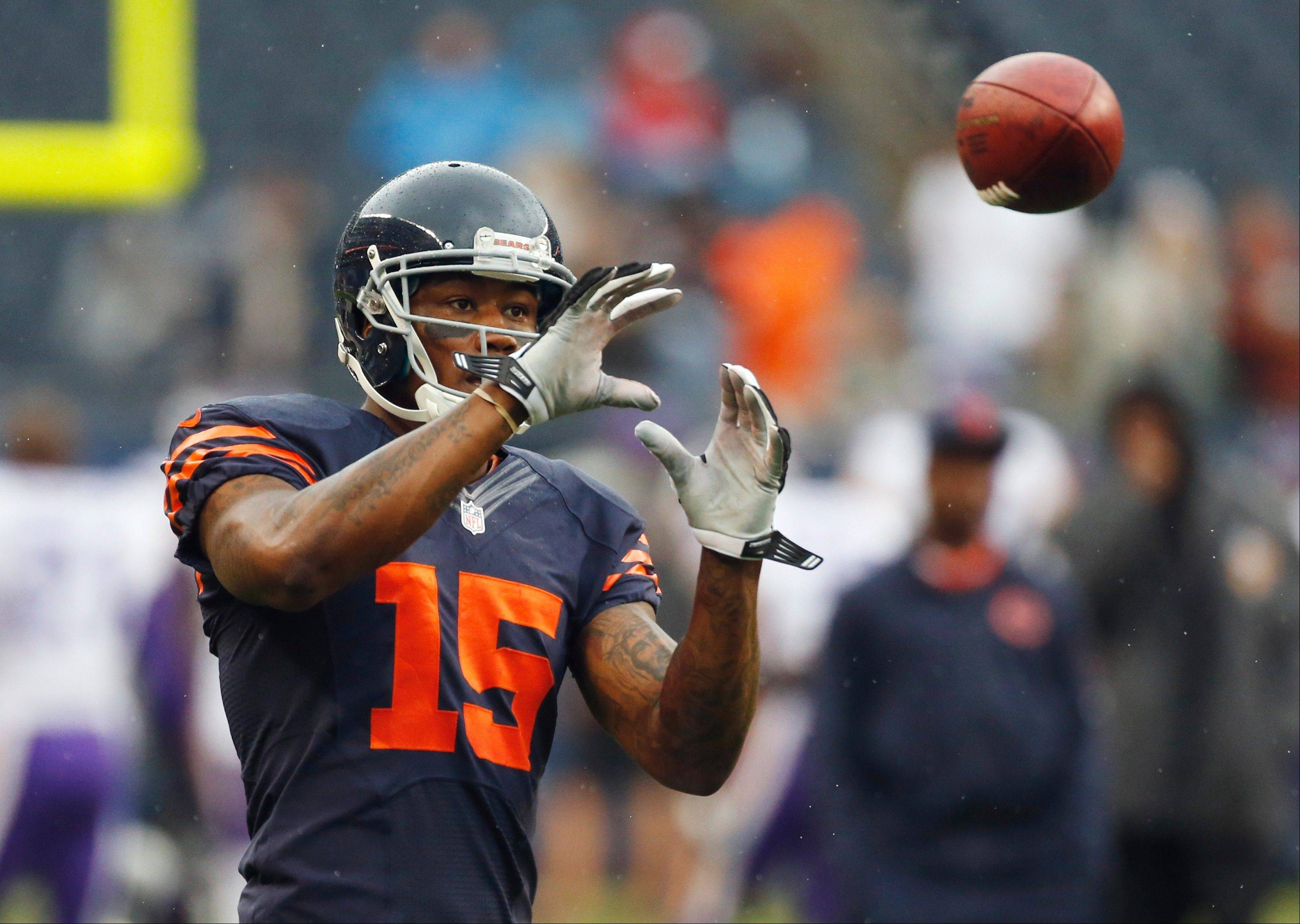 Chicago Bears wide receiver Brandon Marshall catches a pass during warm-ups before an NFL football game against the Minnesota Vikings, Sunday, Sept. 15, 2013, in Chicago.
